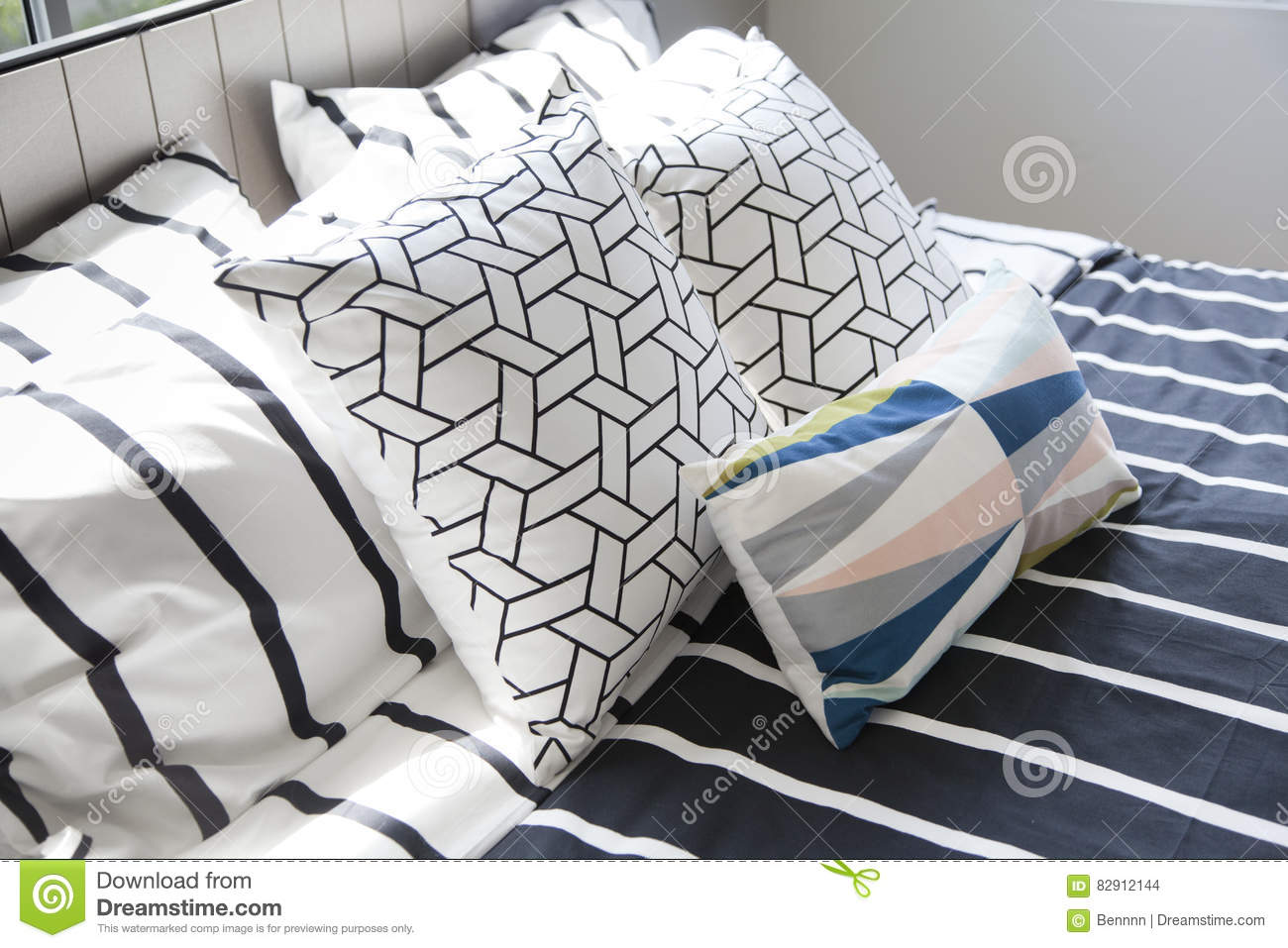 Stylish Bedroom Interior With Black And White Pillows On