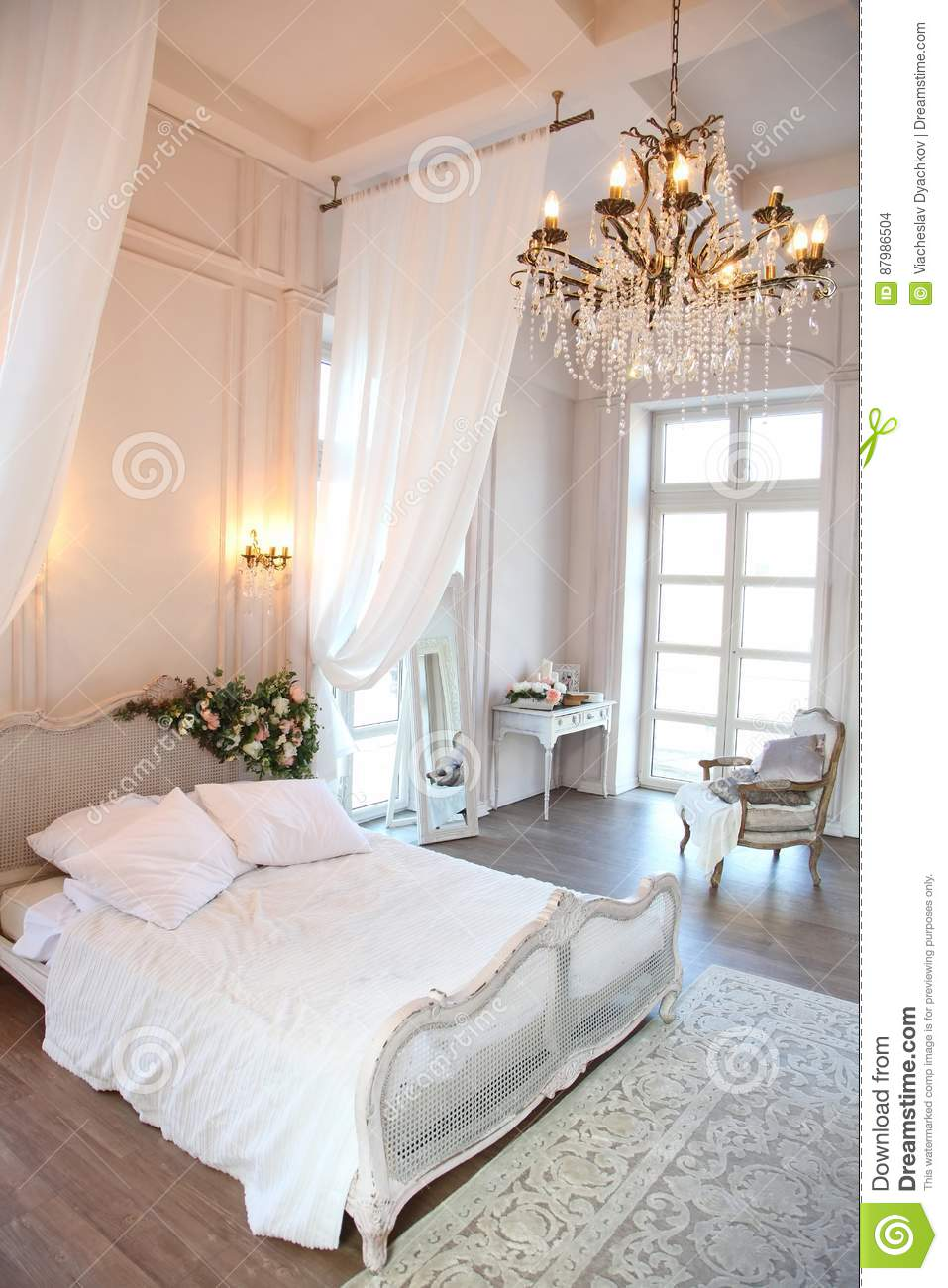 The Interior Of A Beautiful Bedroom Suite In Bright White ...