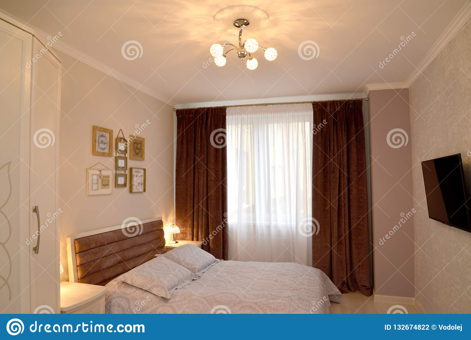 Bedroom Interior With Lighting And The Tv On A Wall Scandinavian Style Stock Photo Image Of Laminate Light 132674822