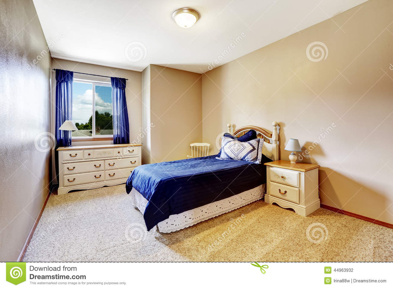 Bedroom interior with navy bedding and curtains stock for Soft carpet for bedrooms