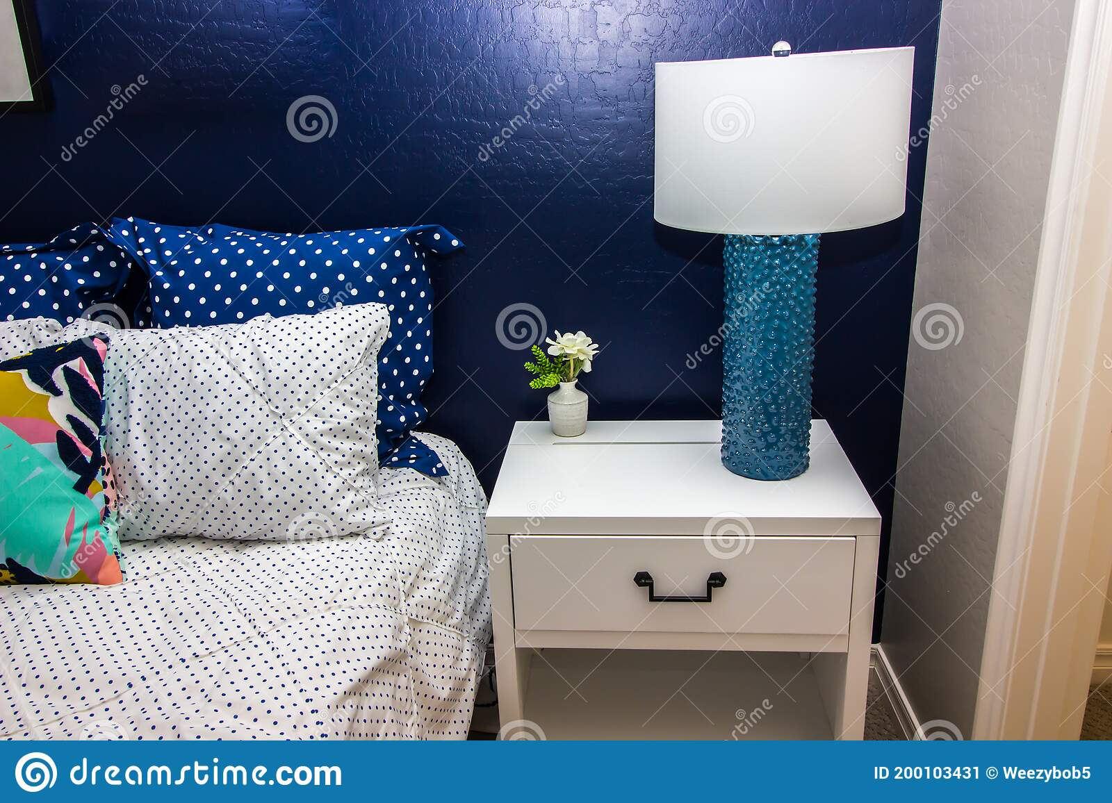 Bedroom With Nightstand Lamp Blue Accent Wall Stock Image Image Of Textured Wall 200103431