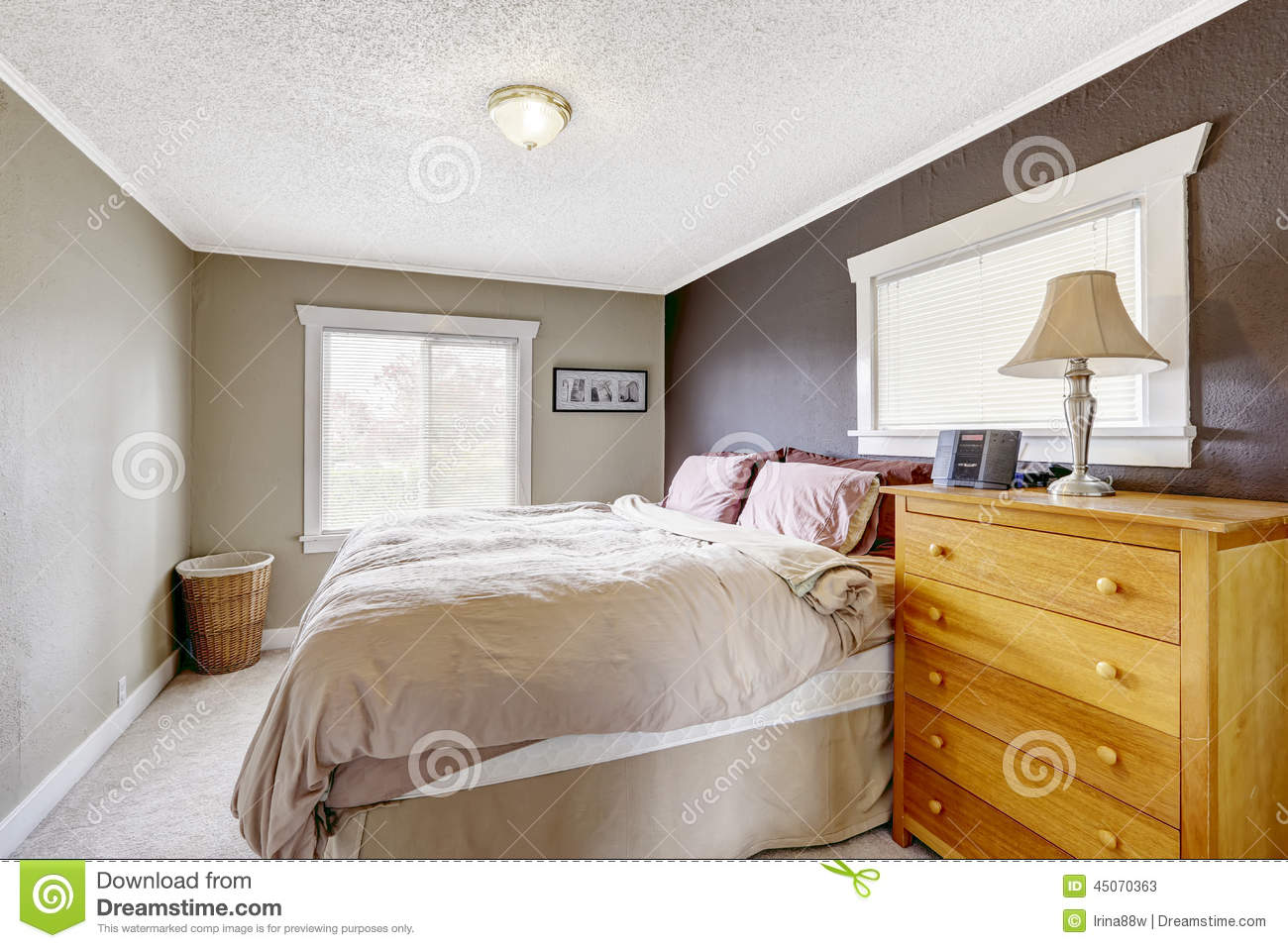 Bedroom With Queen Size Comfortable Bed Stock Photo