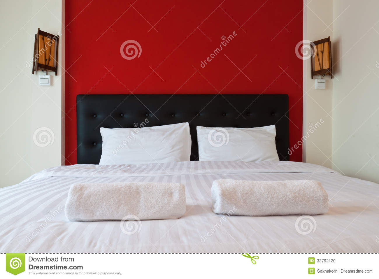 Bedroom With Red Wall Towel On The Bed Stock Photo