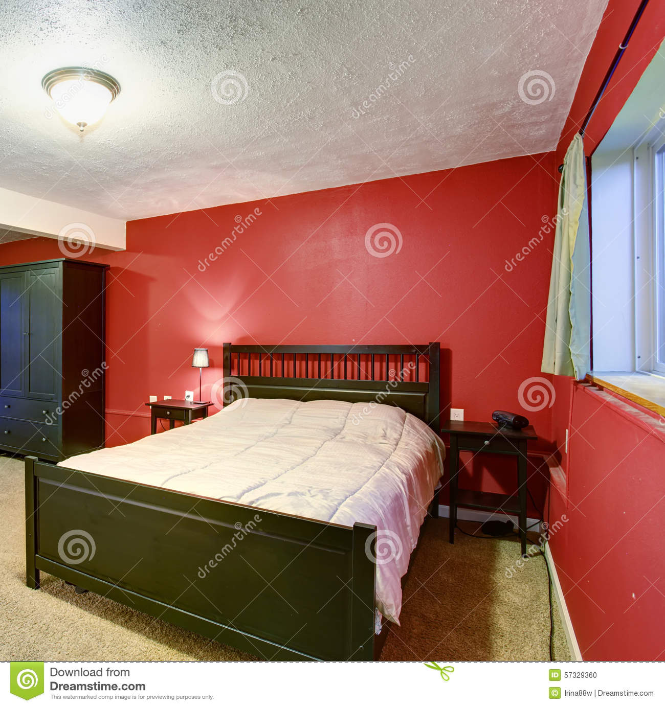 Bedroom With Red Walls Black Color Furniture And Beige Blanket Stock