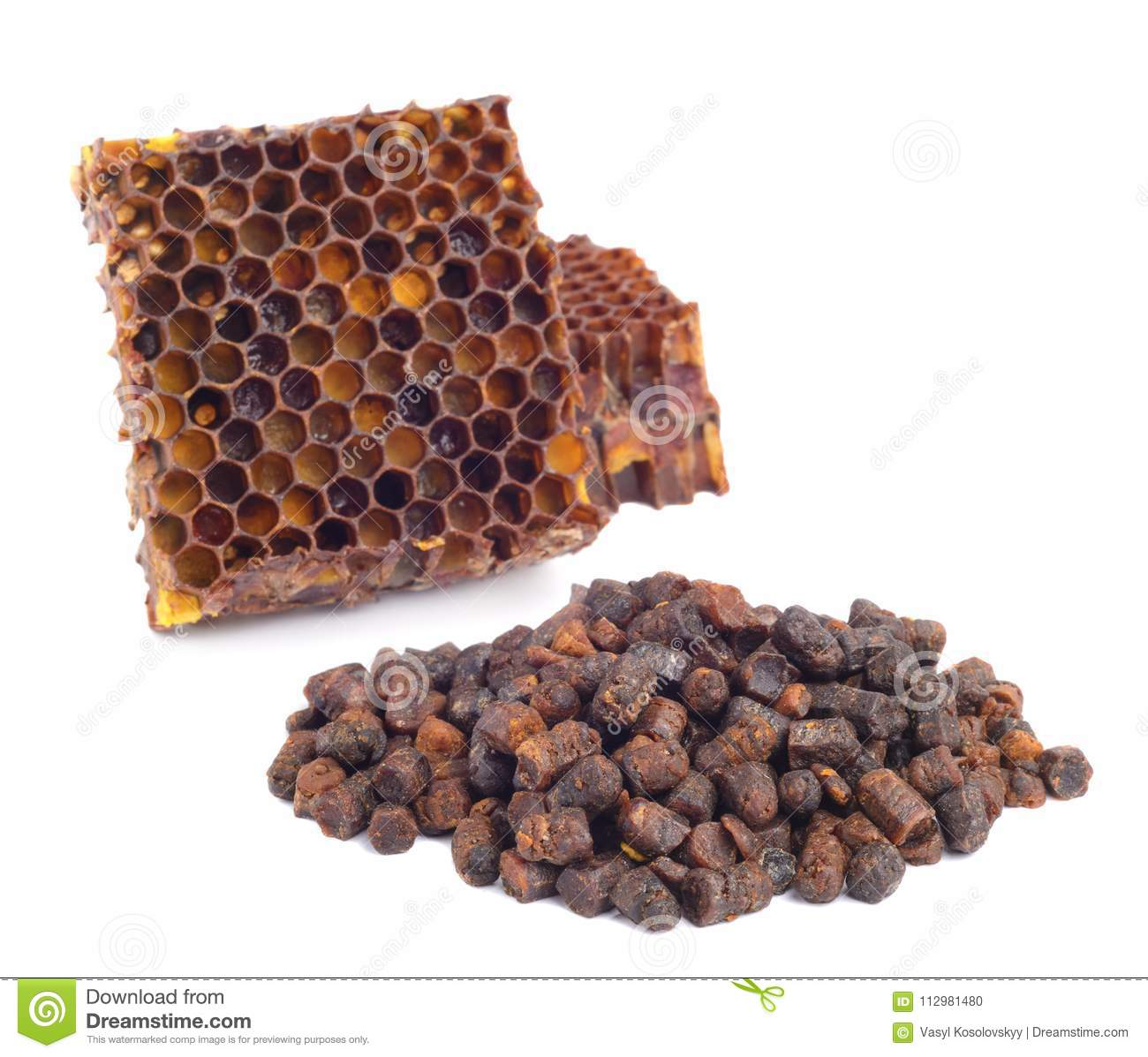 Bee bread granules and a piece of honey cells are isolated on a white background. Natural remedy for immunity enhancement. Beekeep