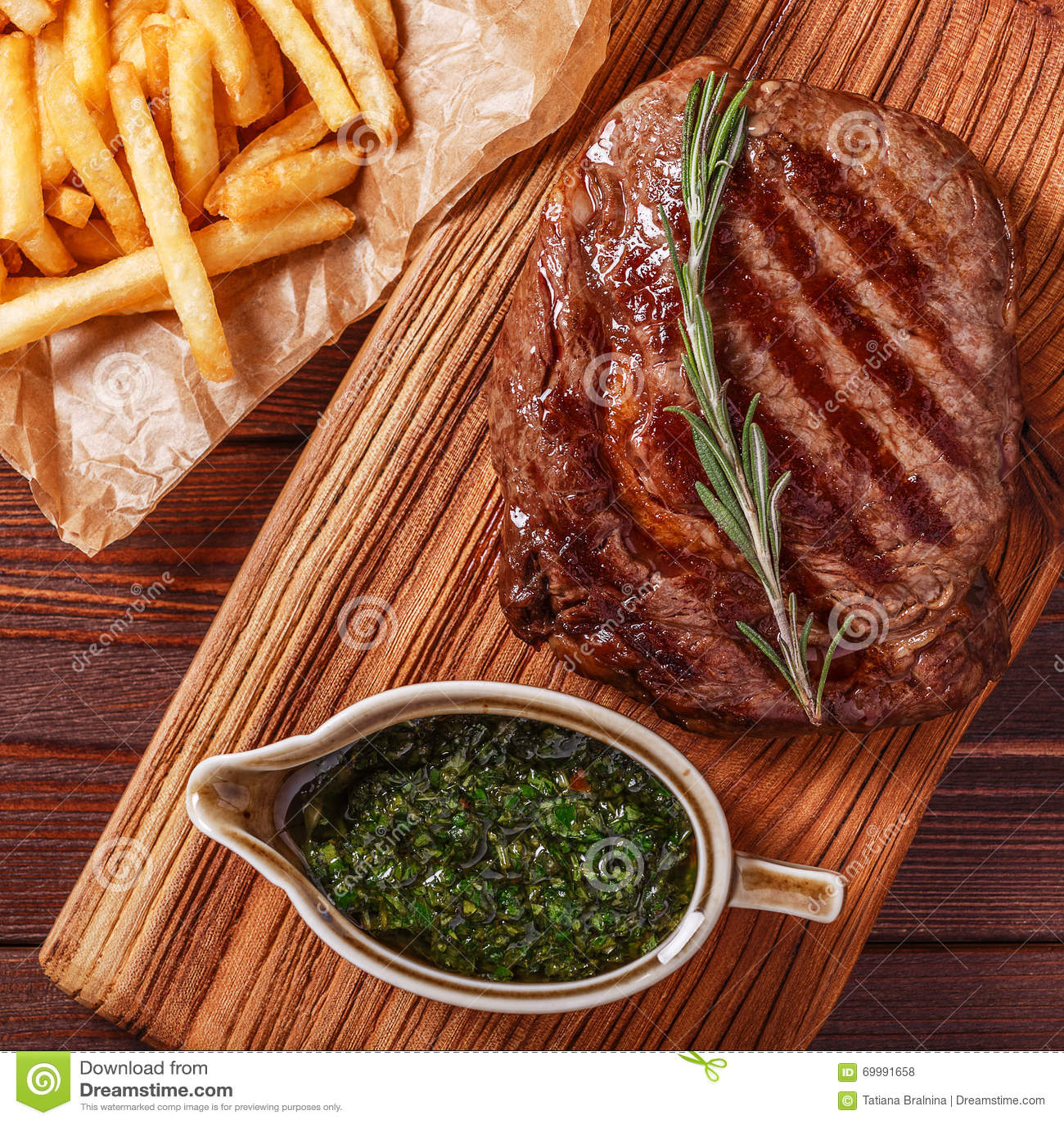Beef barbecue ribeye steak with chimichurri sauce and french fri