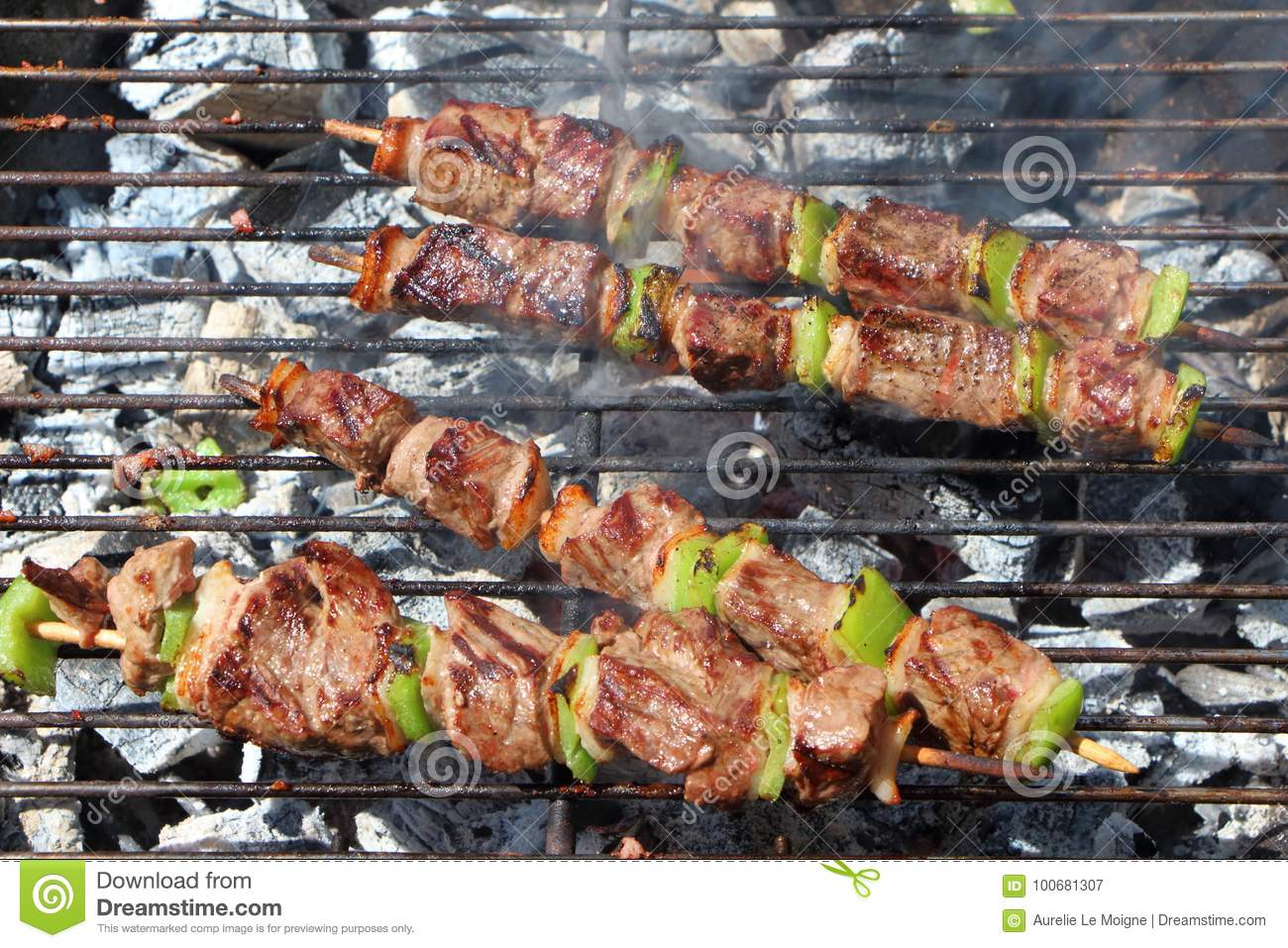 Beef brochette on barbecue