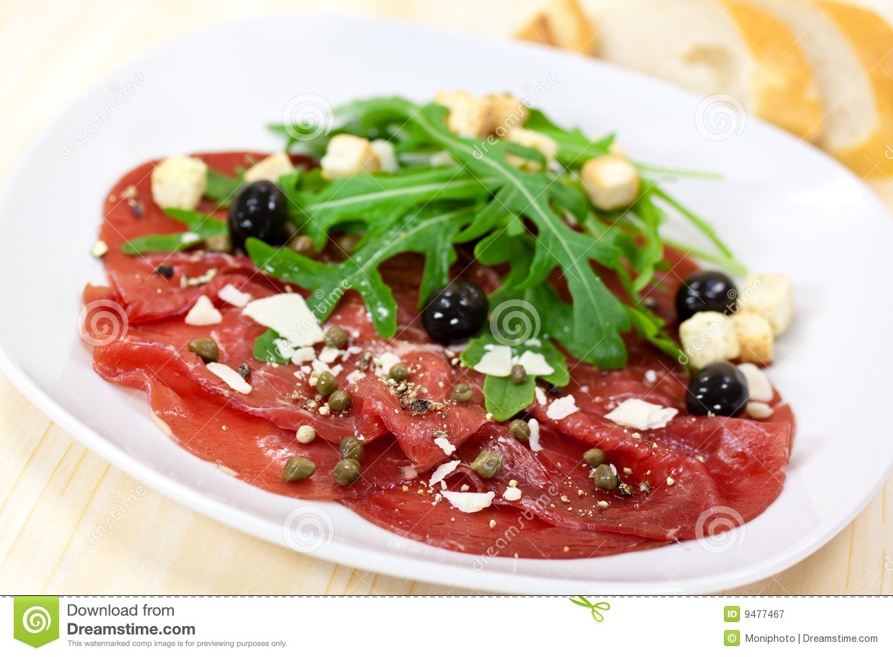 Beef Carpaccio With Pepper, Rucola And Parmesan Royalty Free Stock ...