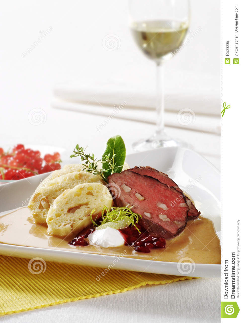 Beef with cream sauce and bread dumplings
