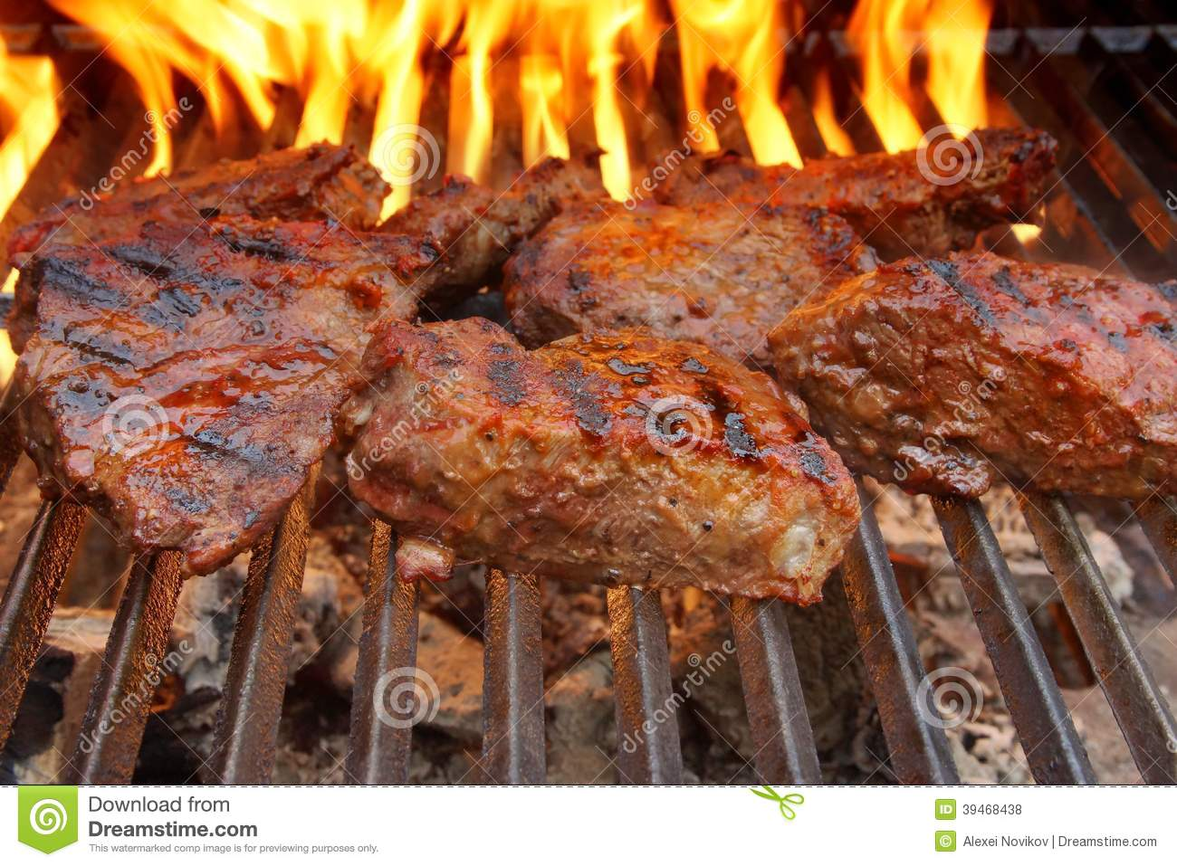 Beef Steak On The BBQ Grill With Flames. Stock Photo ...