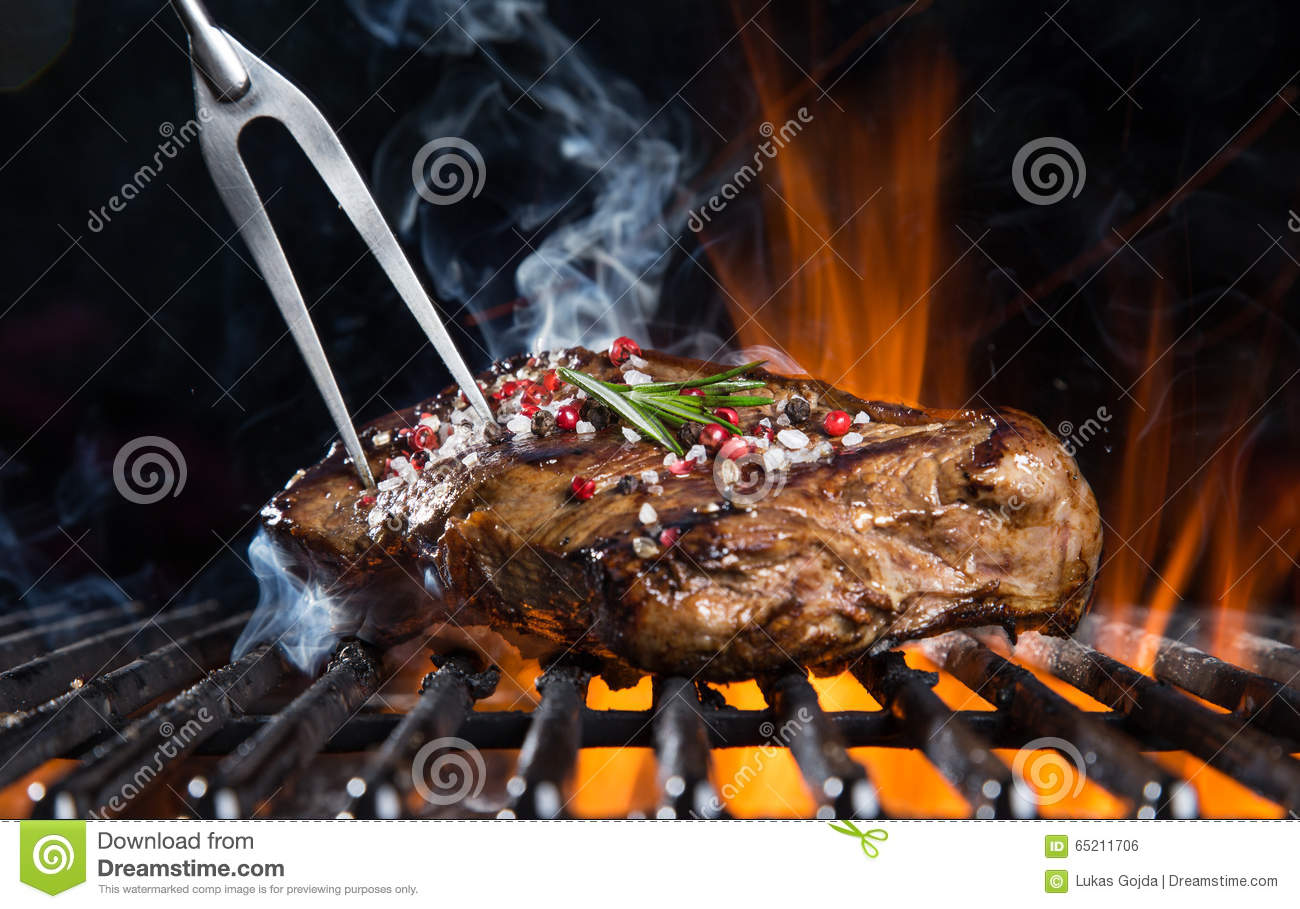 Beef steak on the grill.