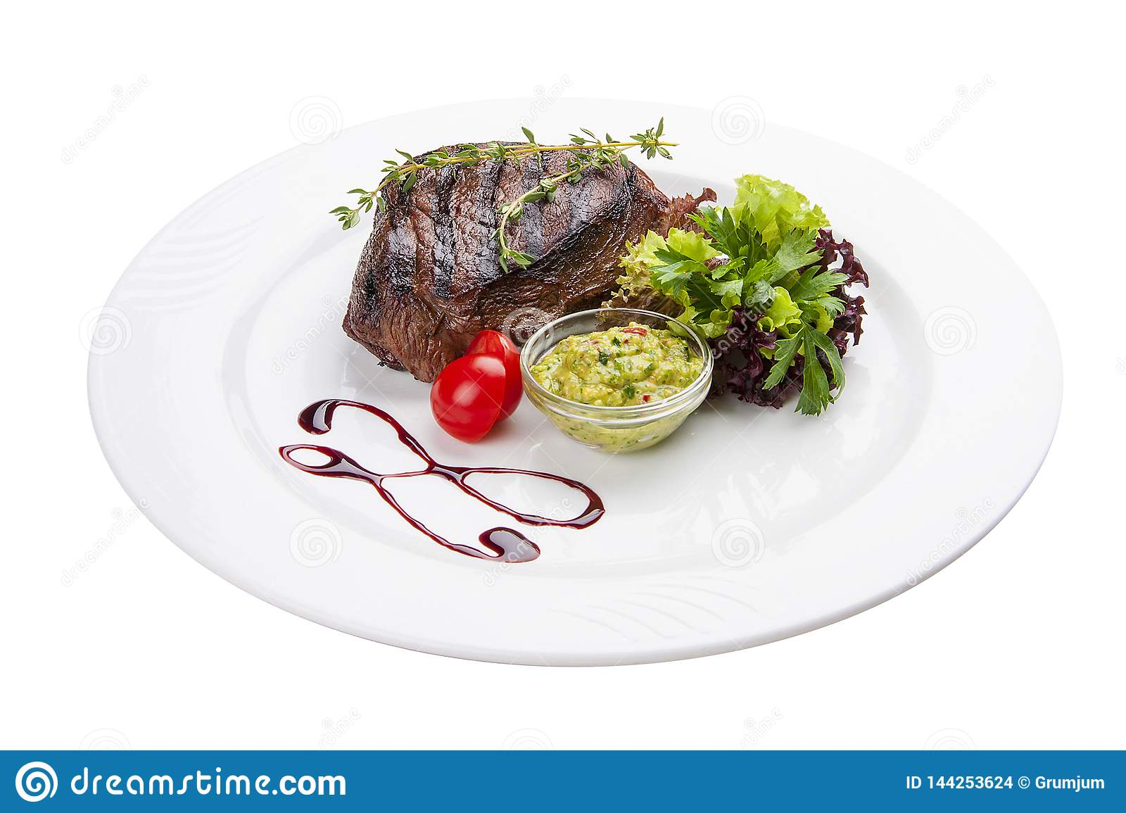 Beef steak with Guacamole sauce. On a white plate