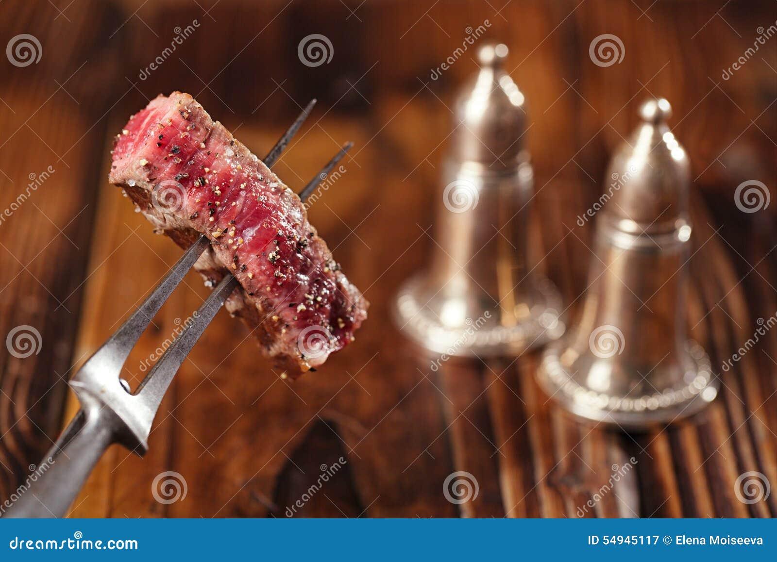 Beef steak Slice on vintage meat fork