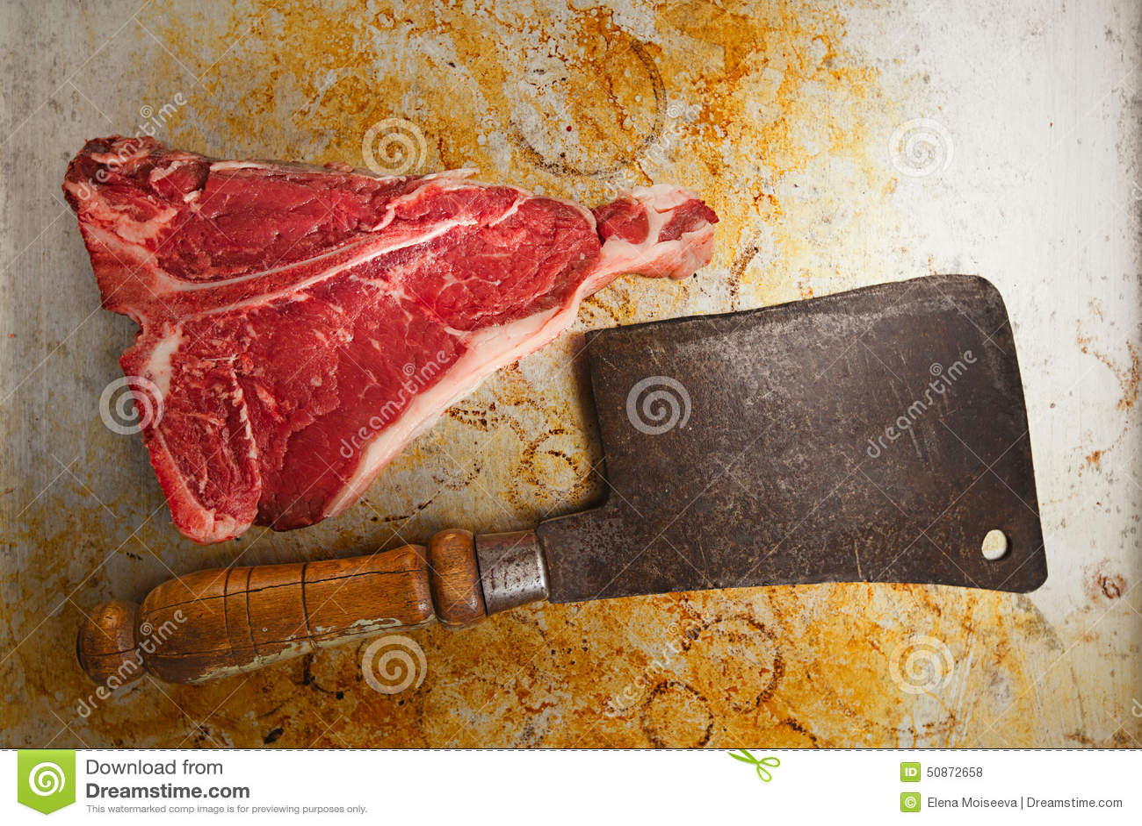 Beef steak t-bone with vintage butcher cleaver knife
