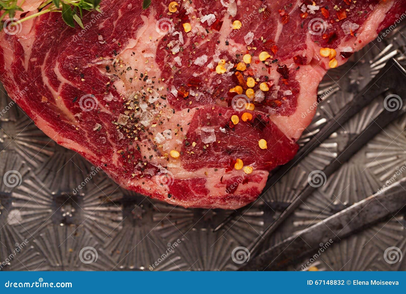 Beef steak t-bone with vintage meat fork