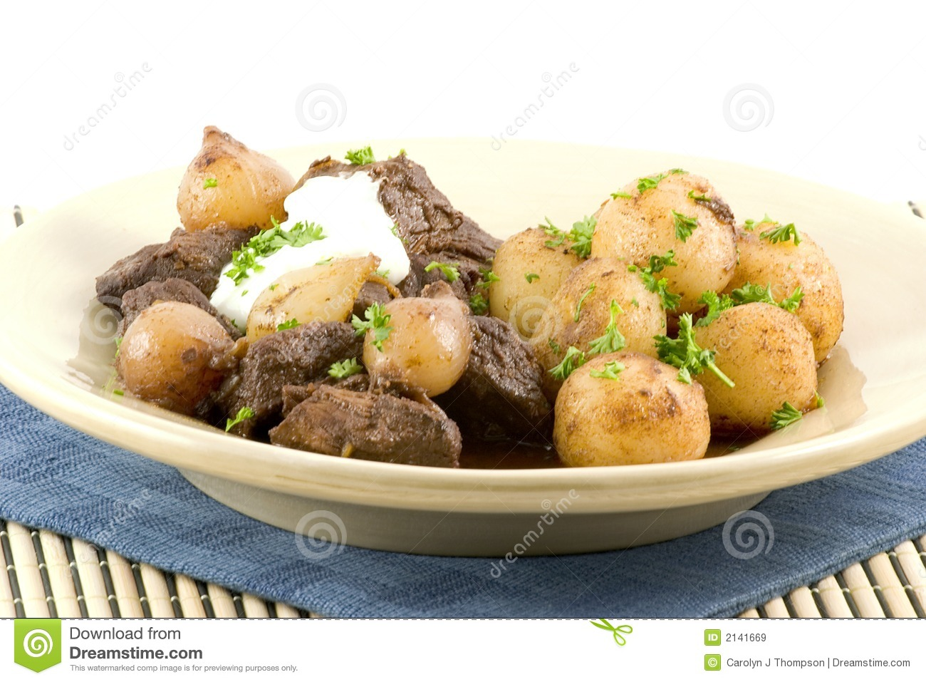 Beef stew slow cooked in the oven with pearl onions and wine, served ...
