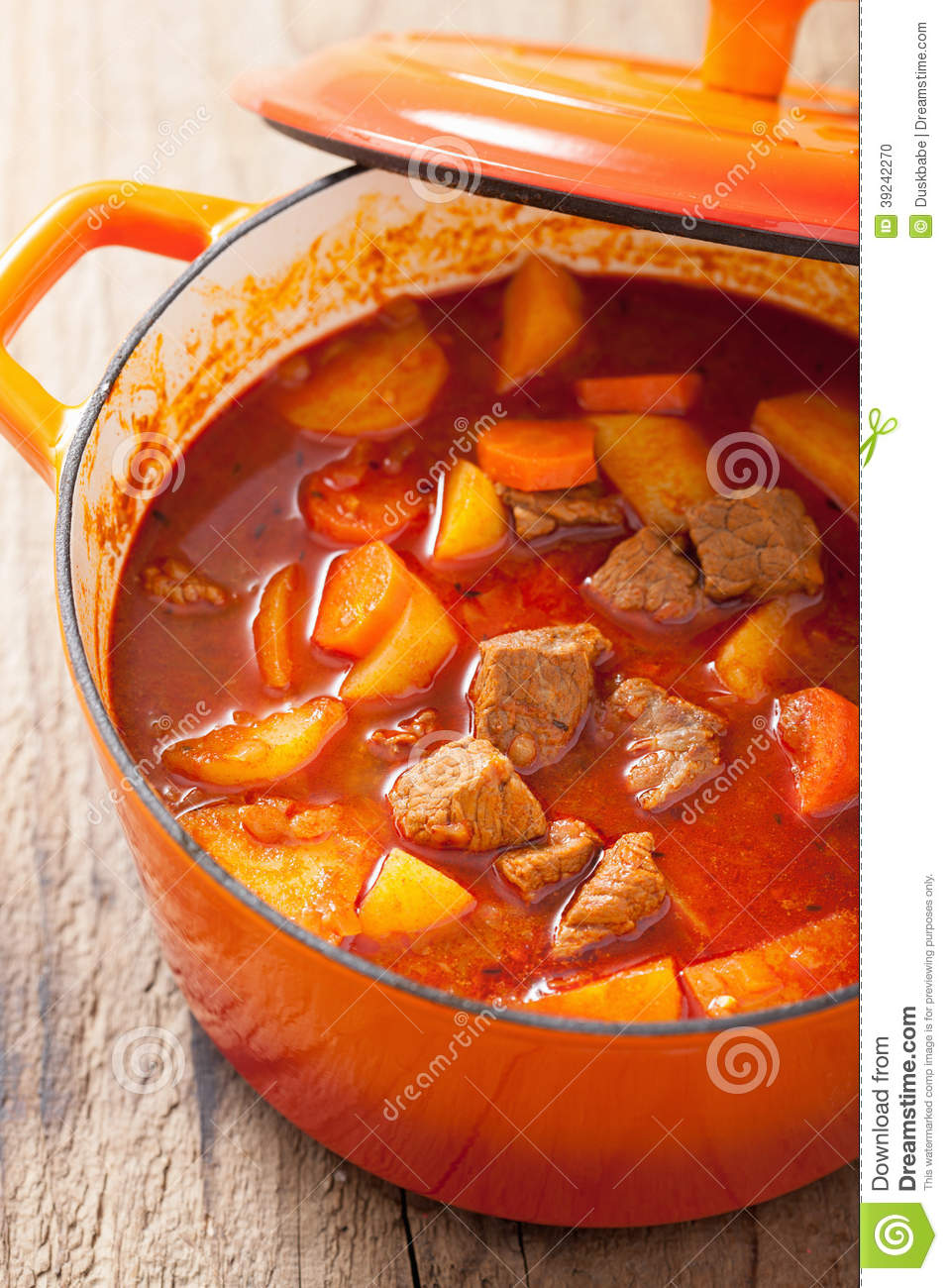 Beef Stew With Potato And Carrot In Red Casserole Stock Photo - Image ...