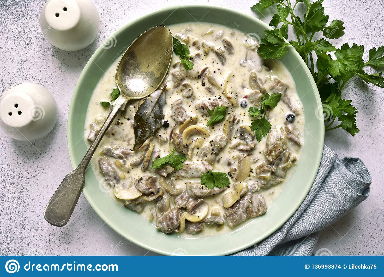 Beef stroganoff - meat stewed in cream sauce with mushrooms.Top view with copy space. Beef stroganoff - meat stewed in cream sauce with mushrooms in a bowl over stock images