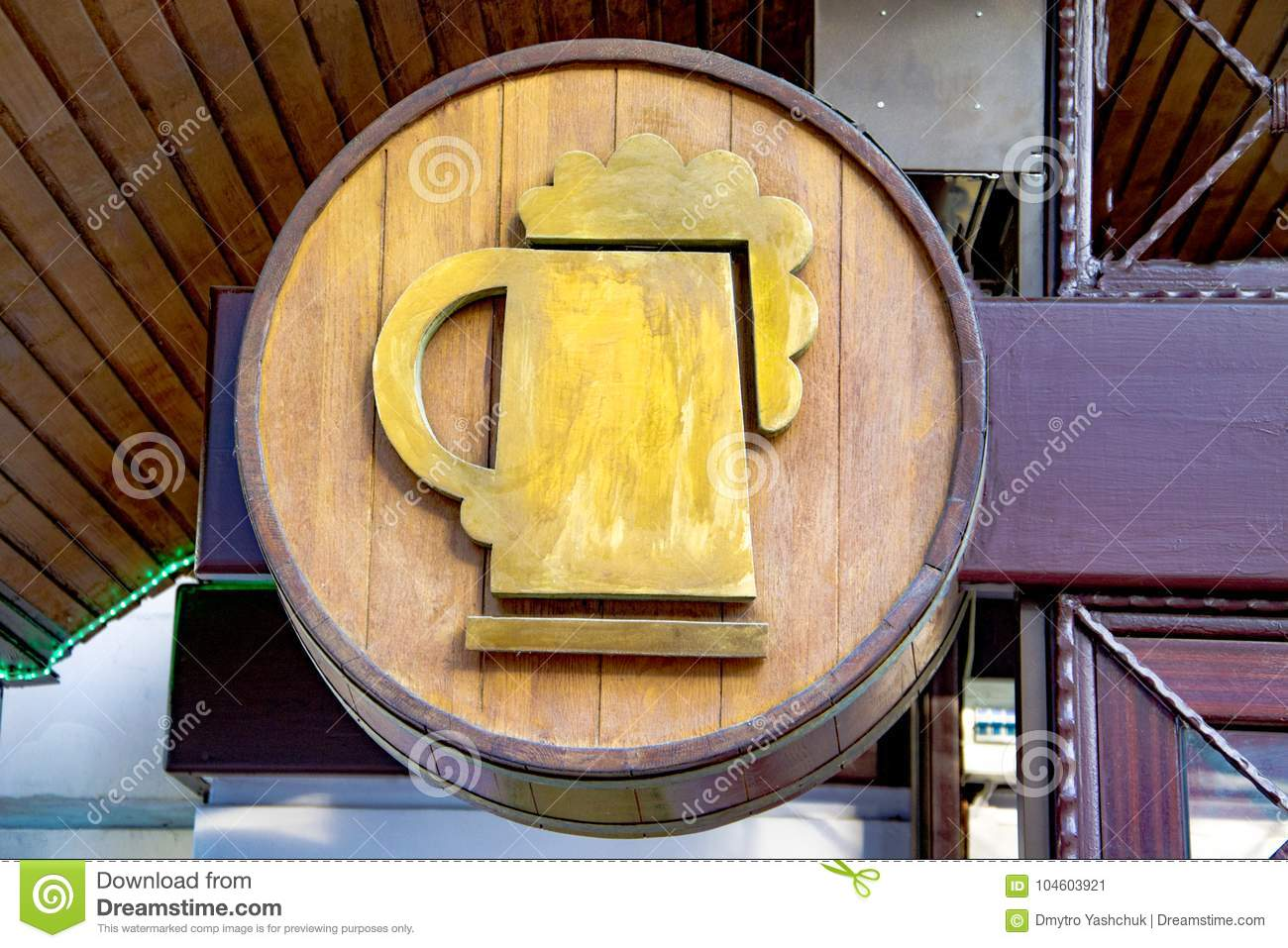 Beer barrel and beer glass is suspended over