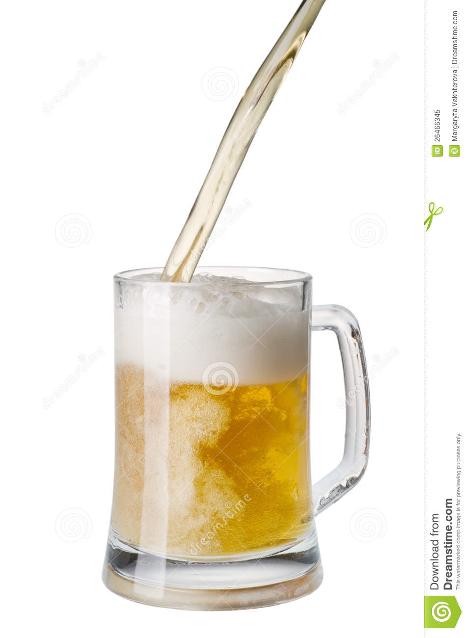 Beer being poured into a mug from a bottle