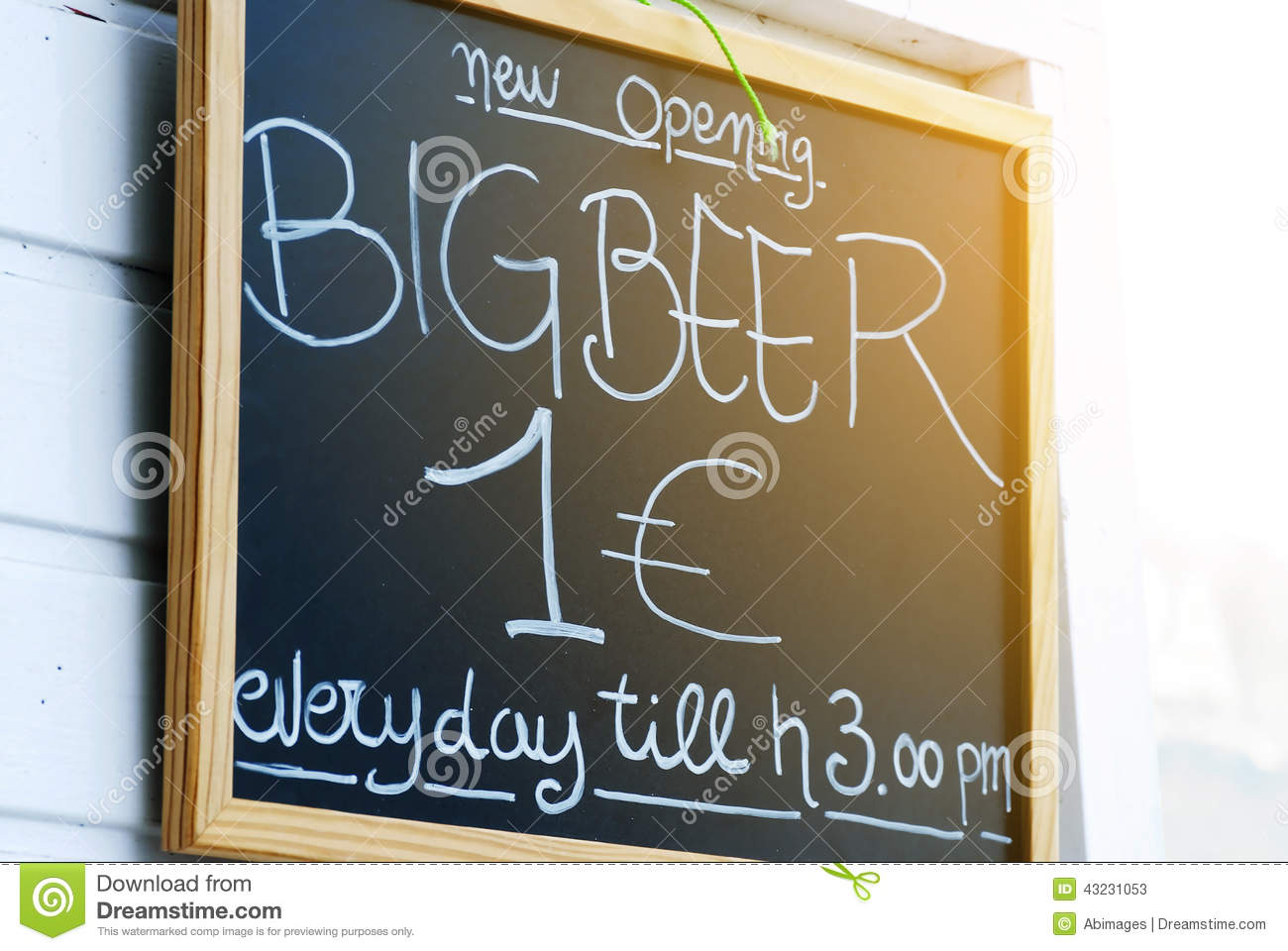 Close up of blackboard advertising beer prices outside a bar in ...