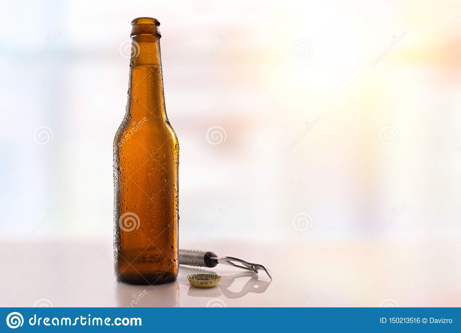 Beer bottle filled and open on glass table light background