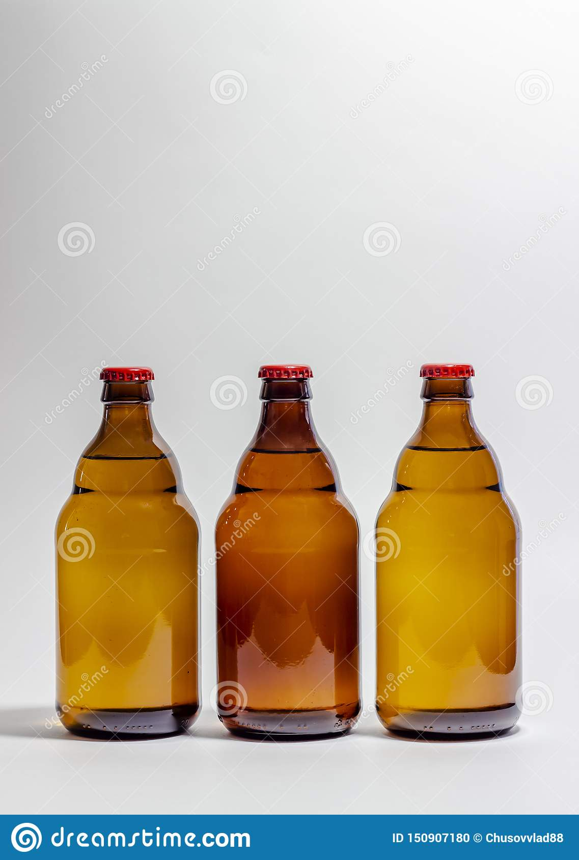 Beer bottles with a red cork on a gray background. Design. Minimalism. Creative idea. Mock-up
