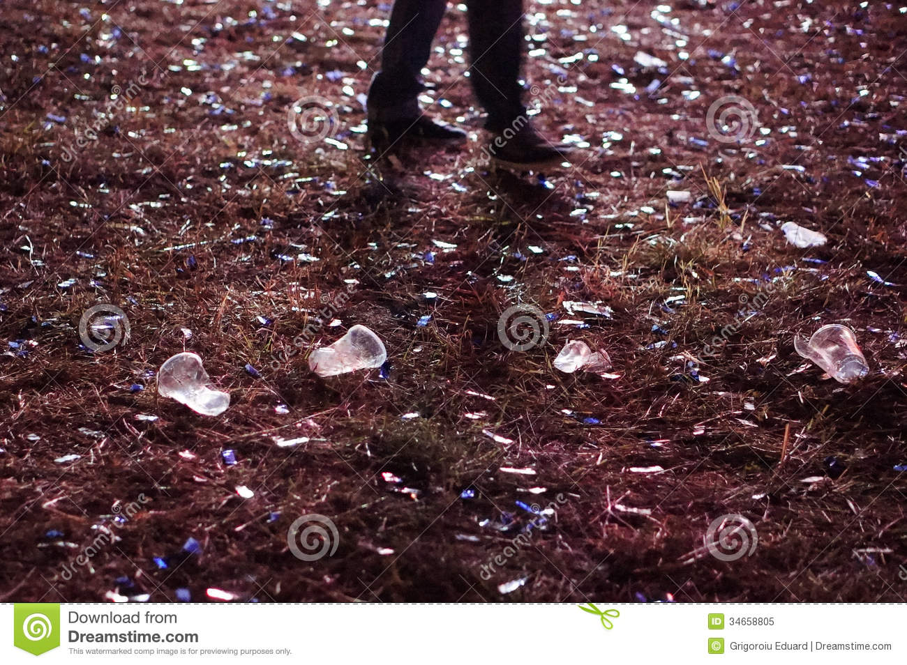 Beer cups and debrees with feet after concert Royalty Free Stock Photo