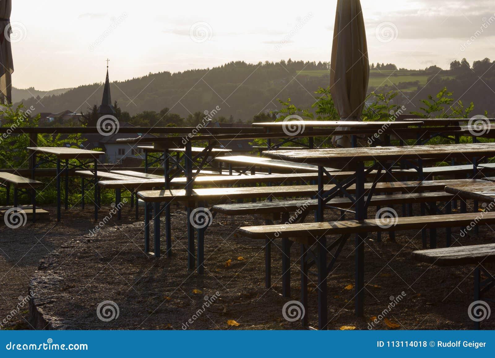 Beer Garden Bench Table And Umbrella Below Big Oak Tree Stock Photo ...