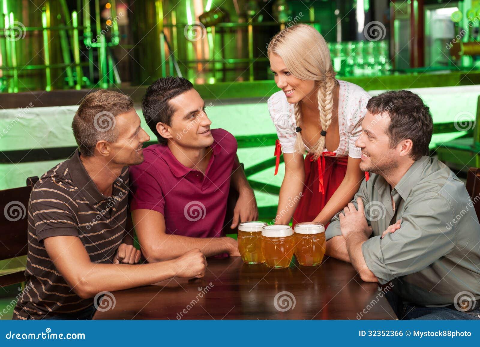 beer for gentlemen beautiful young waitress serving beer