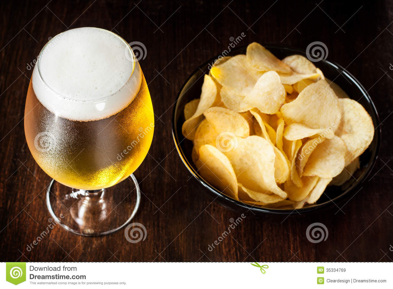Beer glass and chips snack bar or pub menu stock image