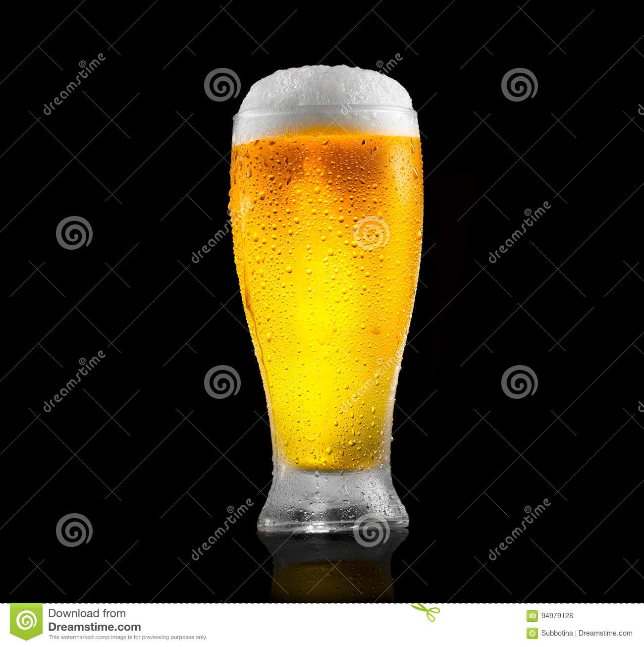 Beer. Glass of cold beer with water drops. Craft beer isolated on black