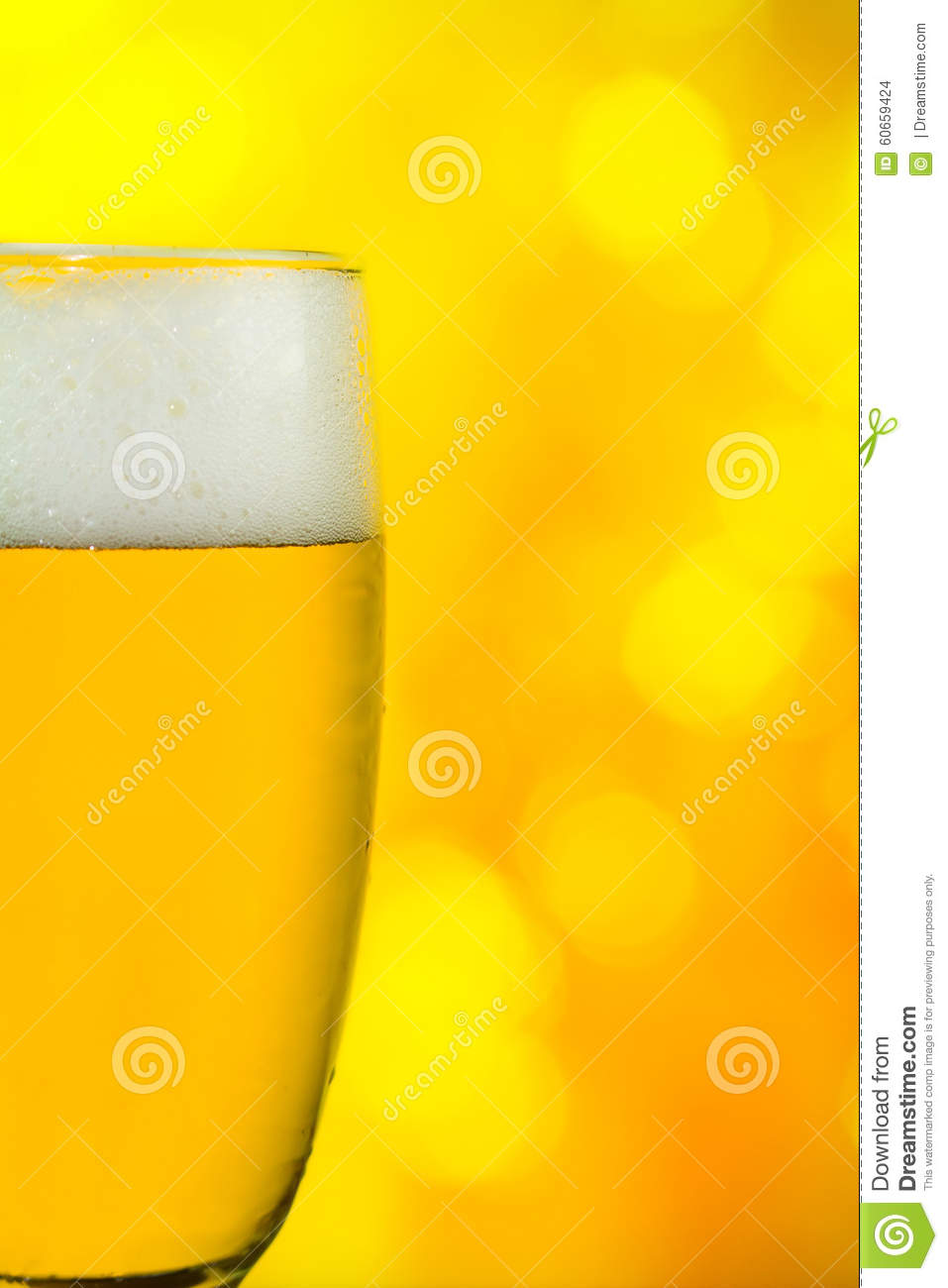 Beer in a glass on yellow blink back light background