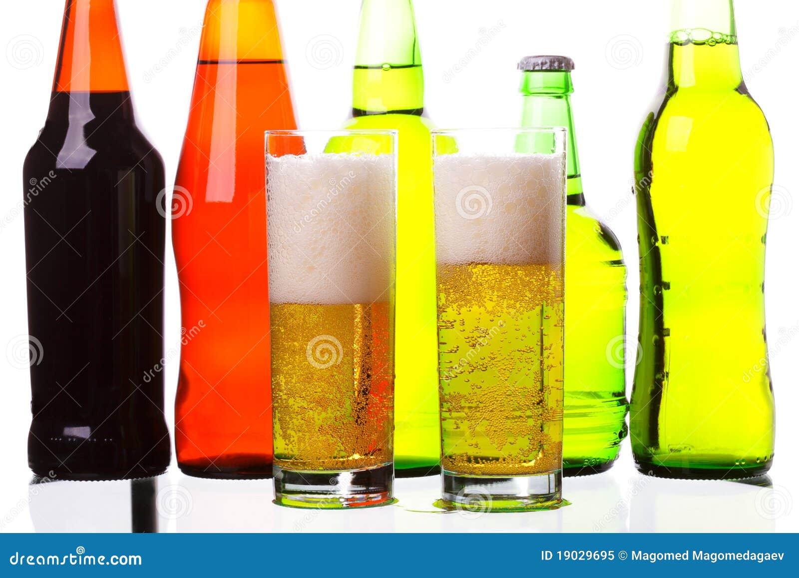 Beer glasses against bottles