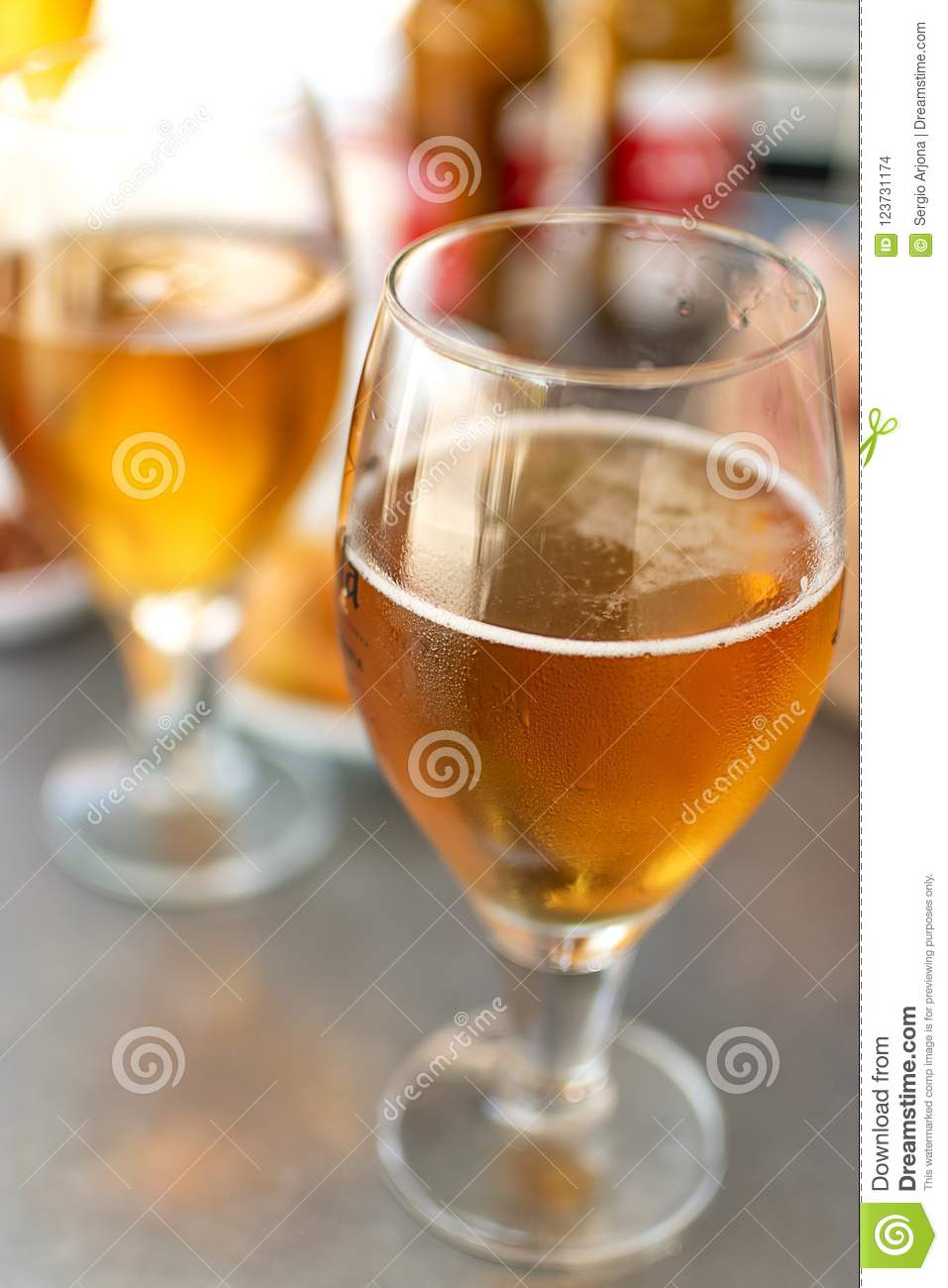Beer glasses with plates to eat