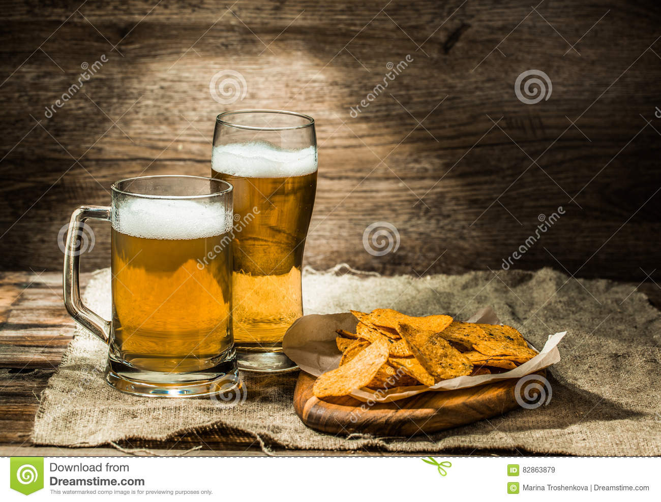 Beer in a mug, glass , chips on board