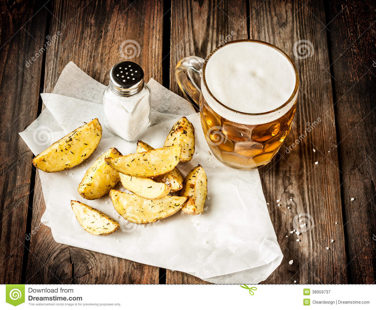 beer mug and potato wedges on rustic wood table stock. Black Bedroom Furniture Sets. Home Design Ideas