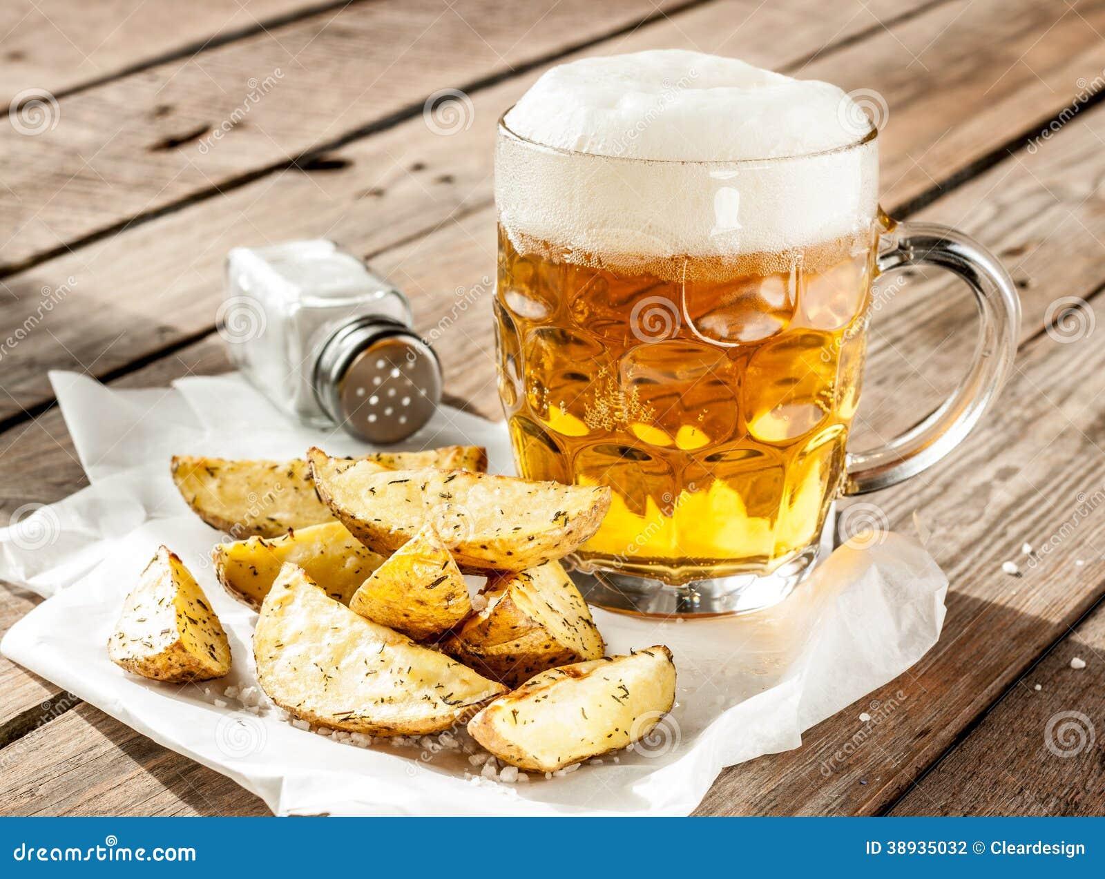 beer mug and potato wedges on wood table stock photo. Black Bedroom Furniture Sets. Home Design Ideas