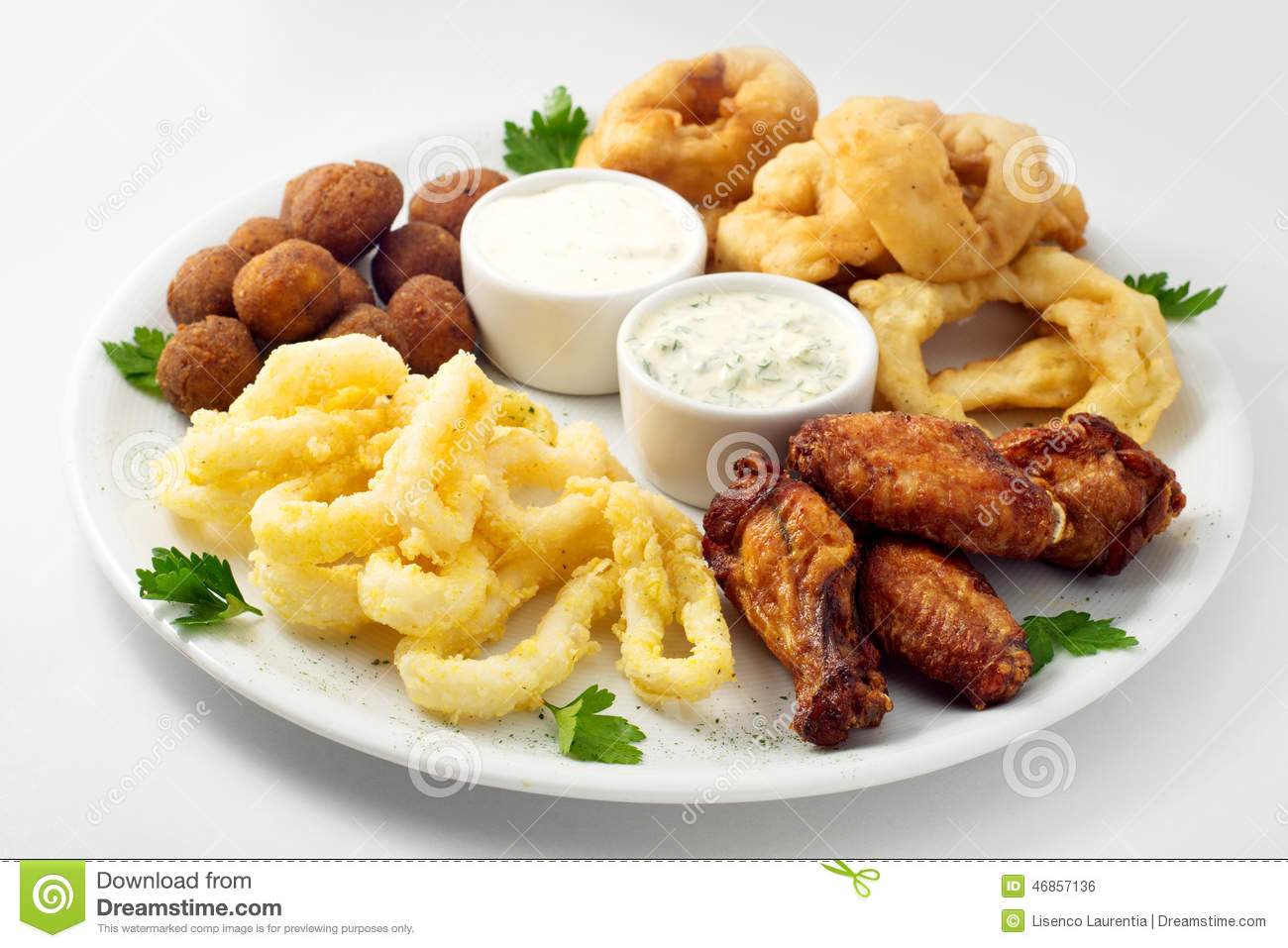 The Beer Plate With Spicy Chicken Wings Calamari Rings Fries Onion Rings Cheese
