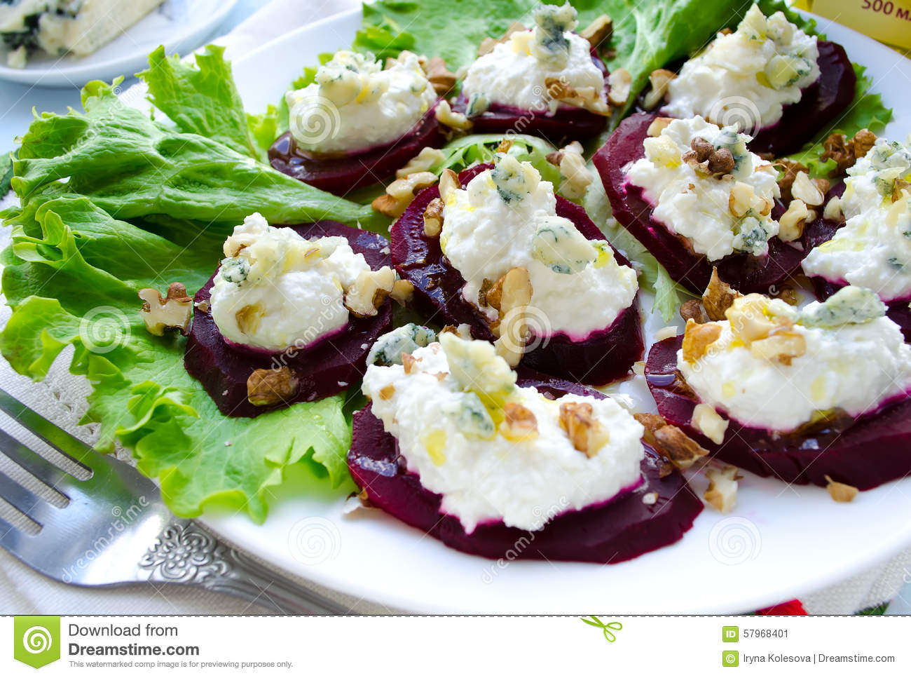 Beet Salad with goat cheese, walnuts, greens and herbs and olive oil.