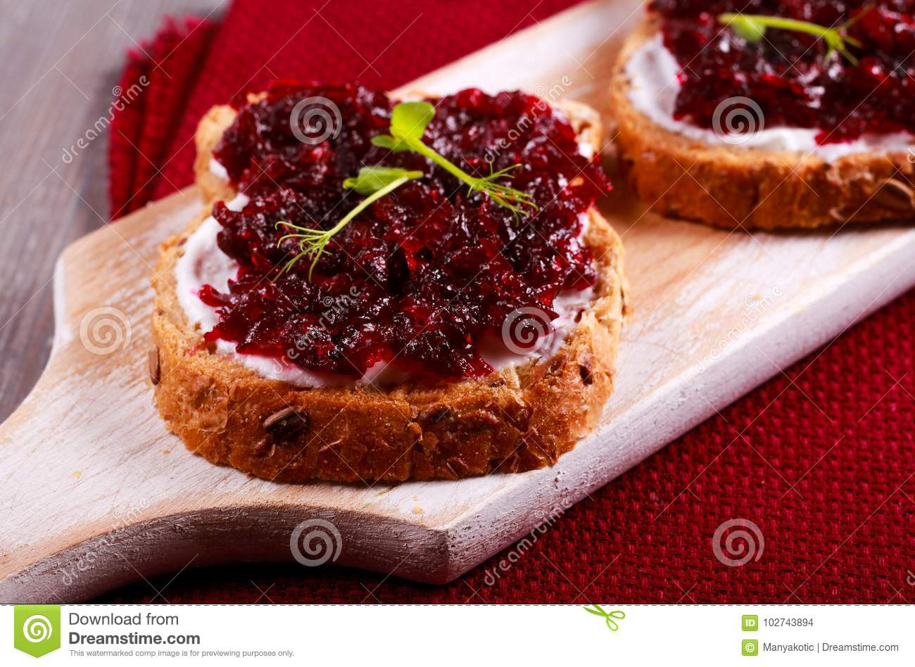 Beetroot relish over brown bread
