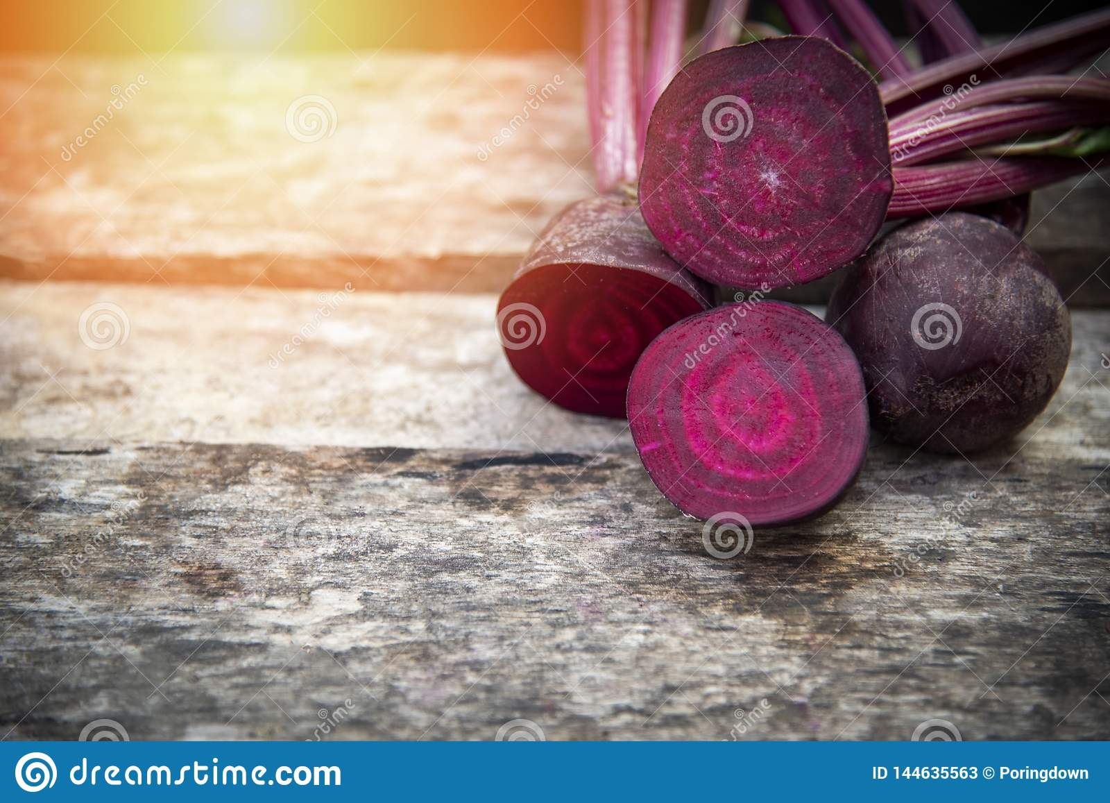 Beetroot slice Fresh red beet roots on wooden background