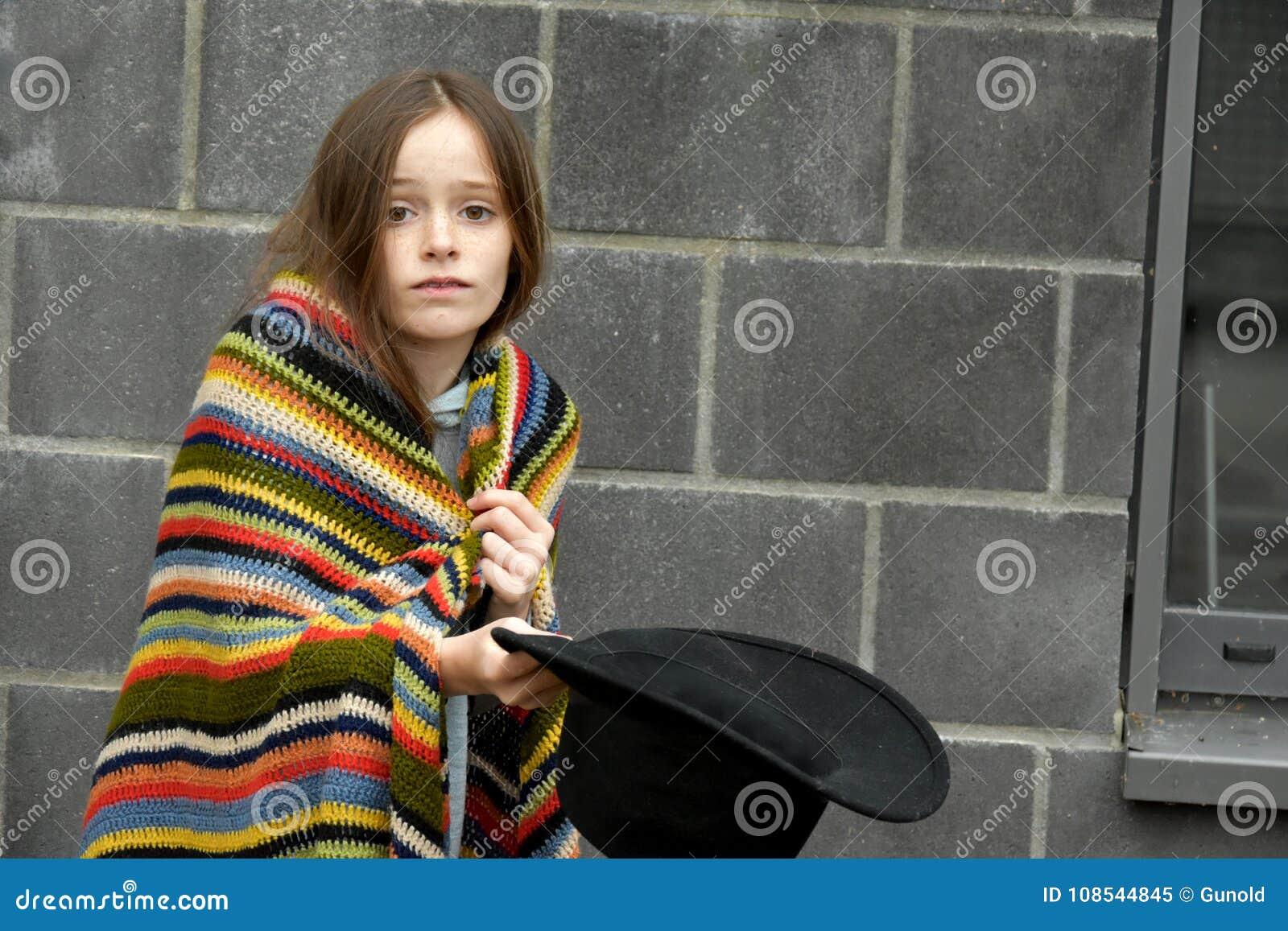 Beggar girl asking for a little money