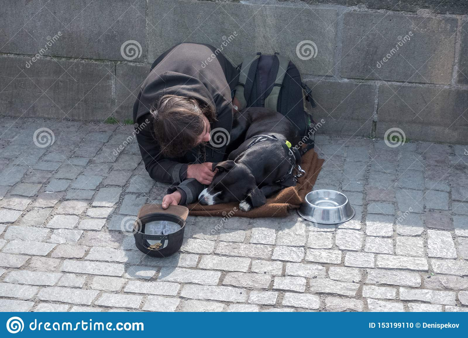 Beggar, homeless with Dog near Charles Bridge, Prague, Czech republic