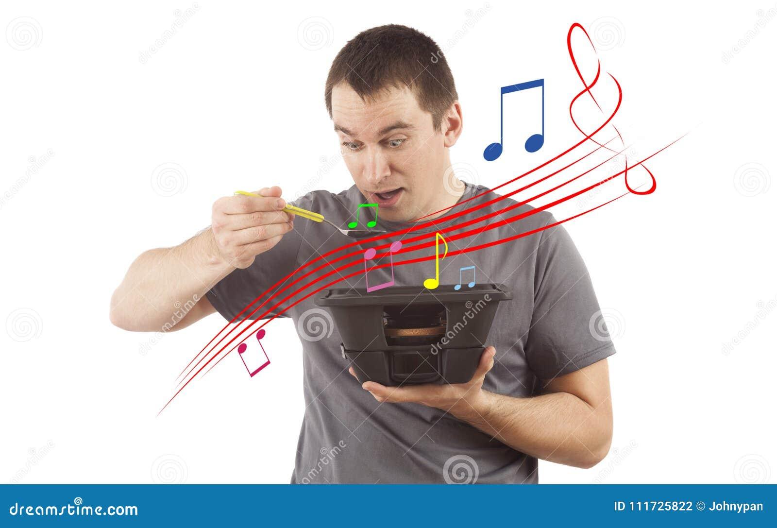 Begrepp av mannen som äter musik