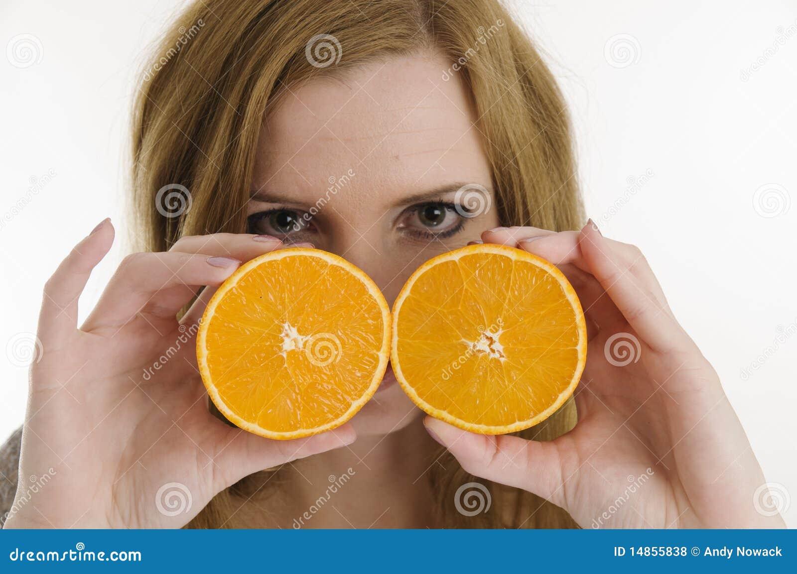 Behind the oranges