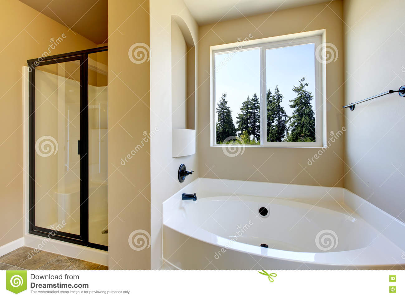 Beige Bathroom Interior With White Bath Tub And Glass Shower Stock ...