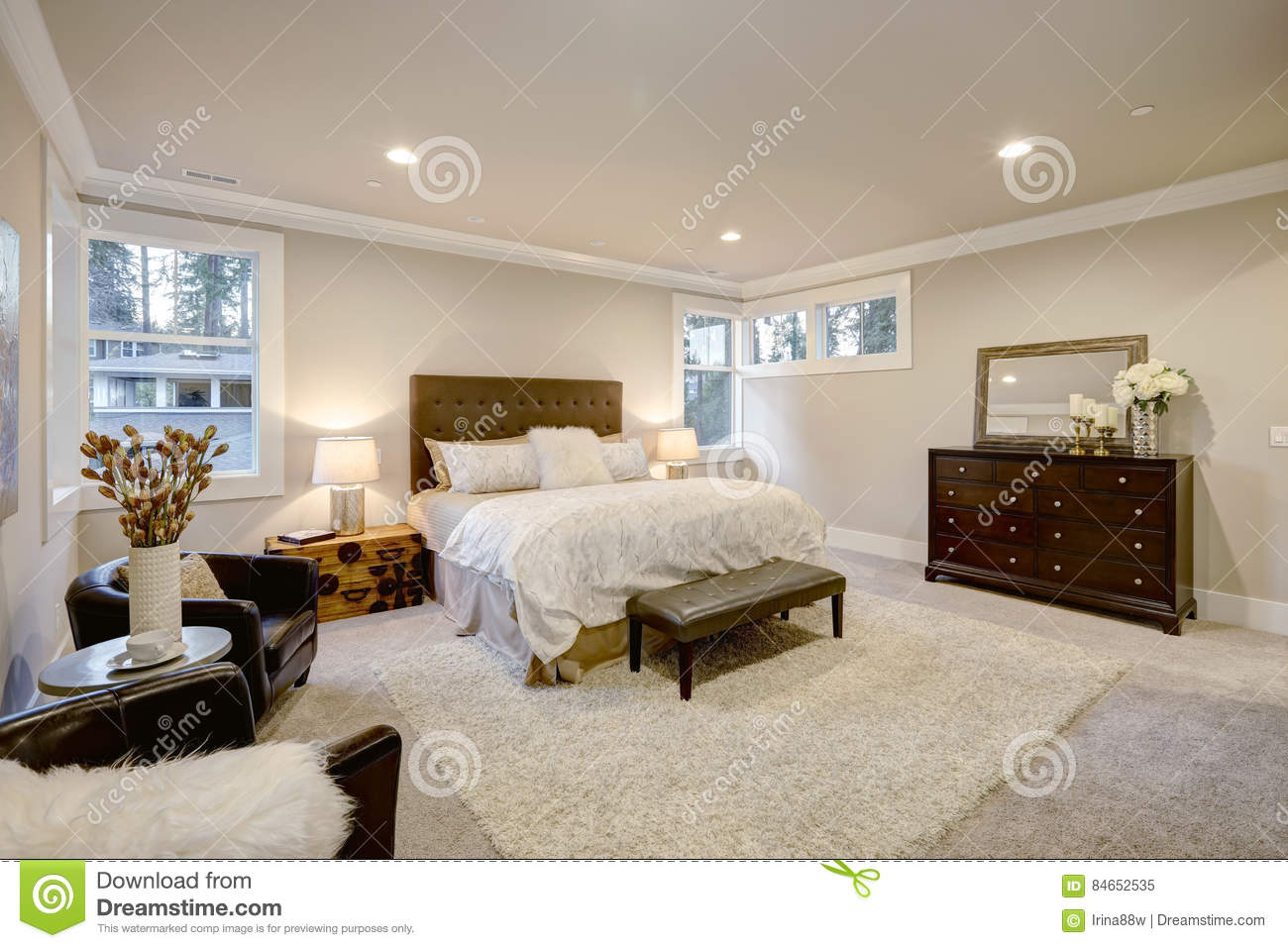 Beige And Brown Master Bedroom Boasts Tufted Queen Bed Stock Image Image Of Open Bright 84652535