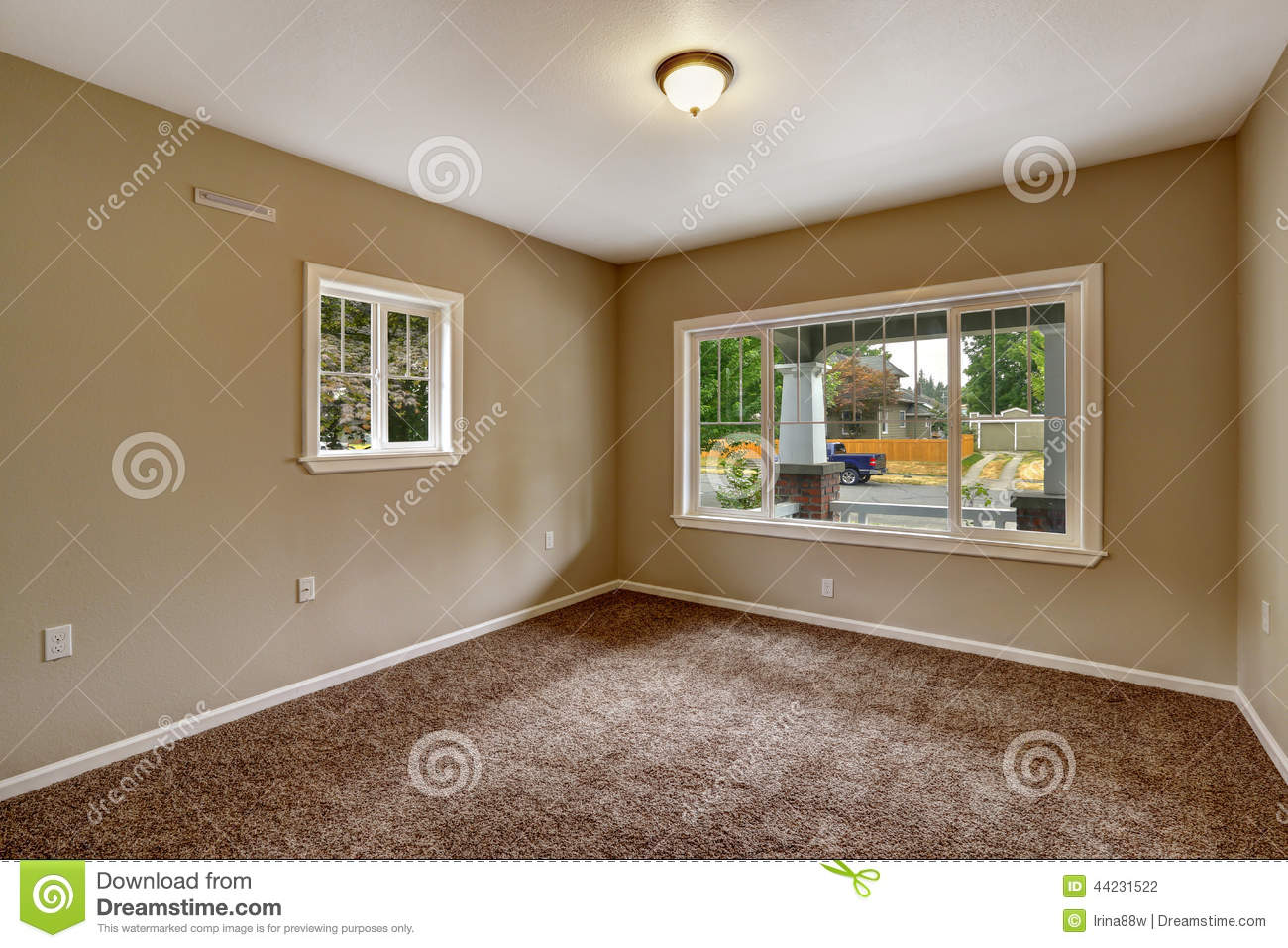 Beige empty room with brown carpet floor stock photo for Paint colors for brown carpet