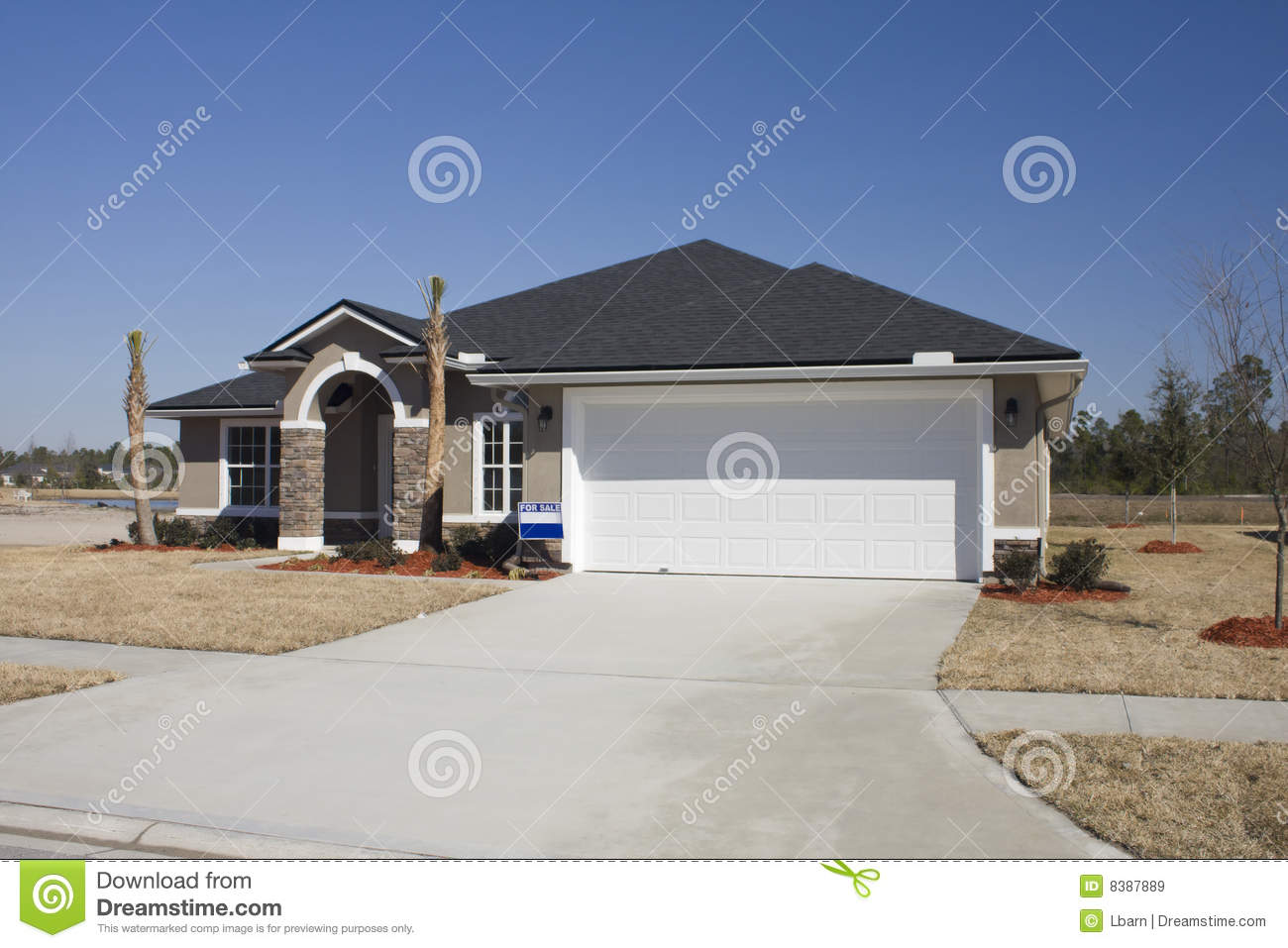 Beige home with earthtone stone accents stock image for Stucco homes with stone accents